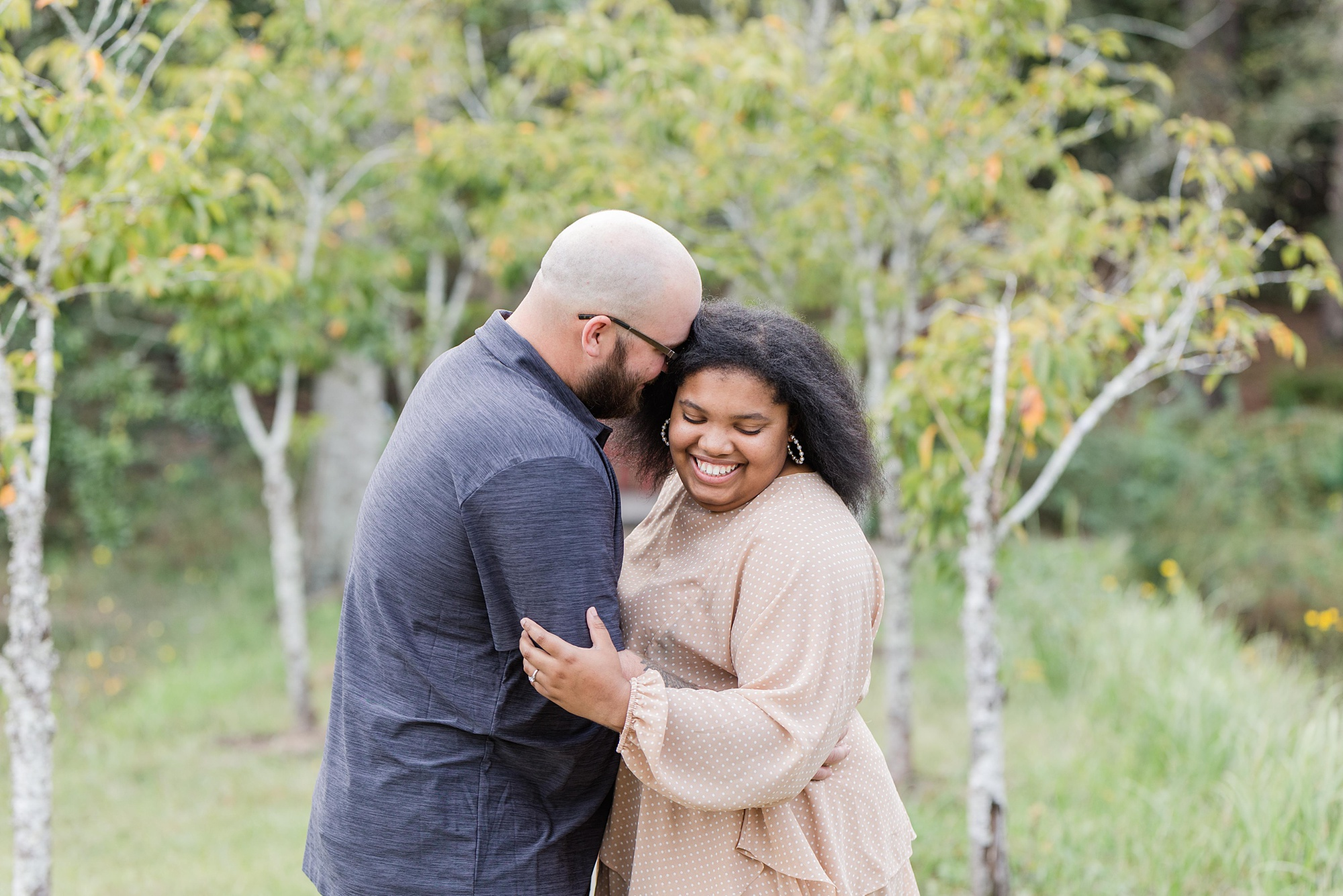 groom makes bride laugh during Japanese Garden Engagement Session