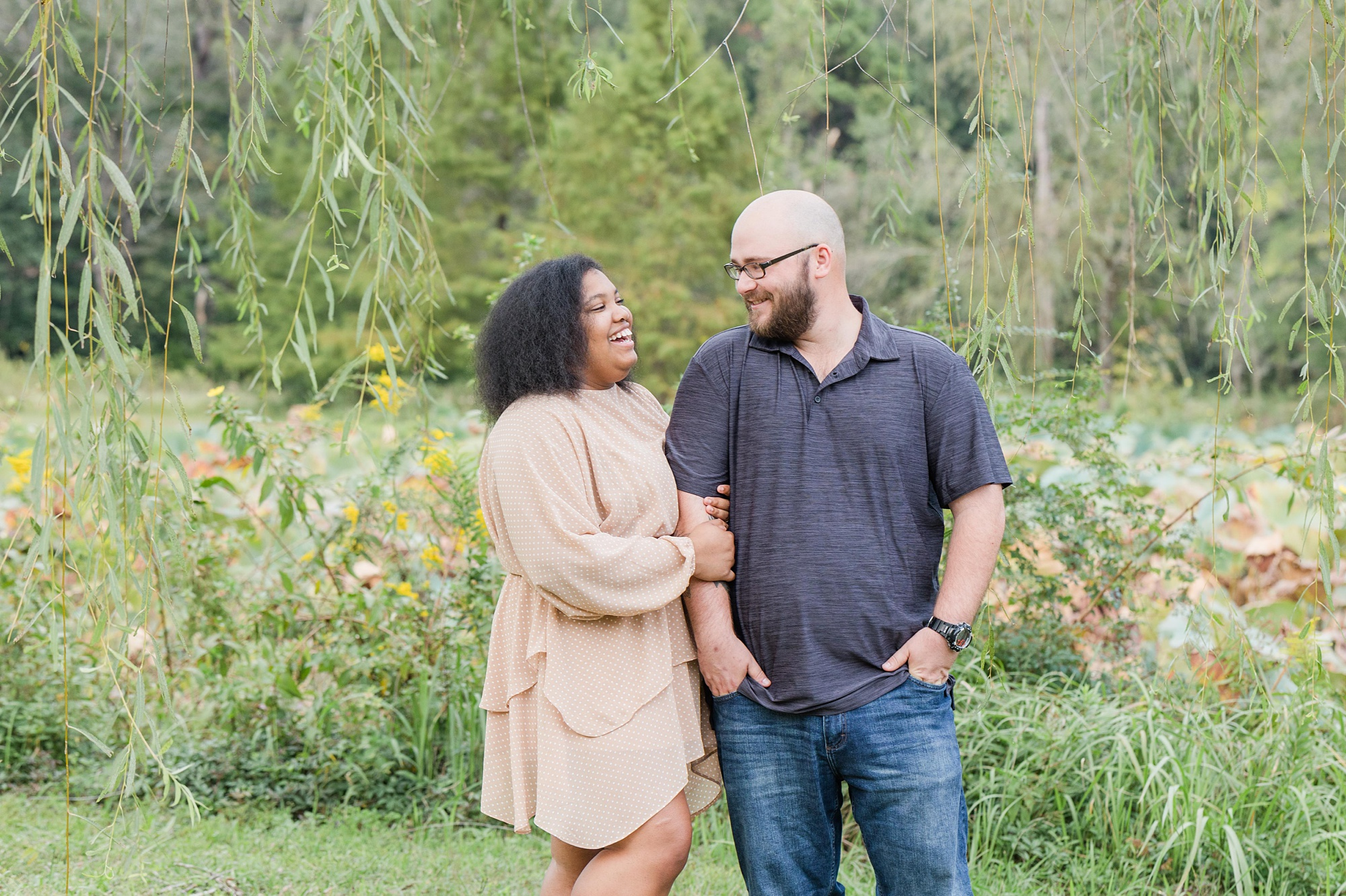 bride and groom look at each other during Japanese Garden Engagement Session