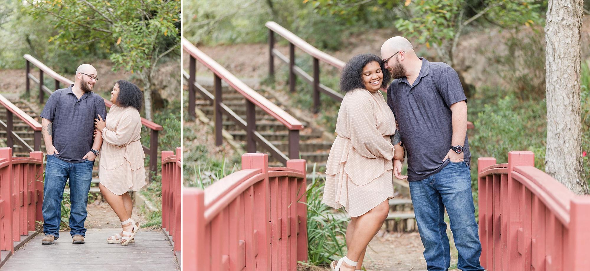 couple poses on walkway in Japanese Garden