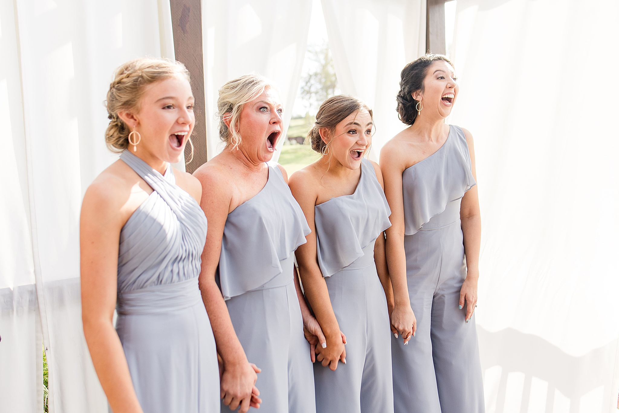 bridesmaids react to seeing bride for the first time