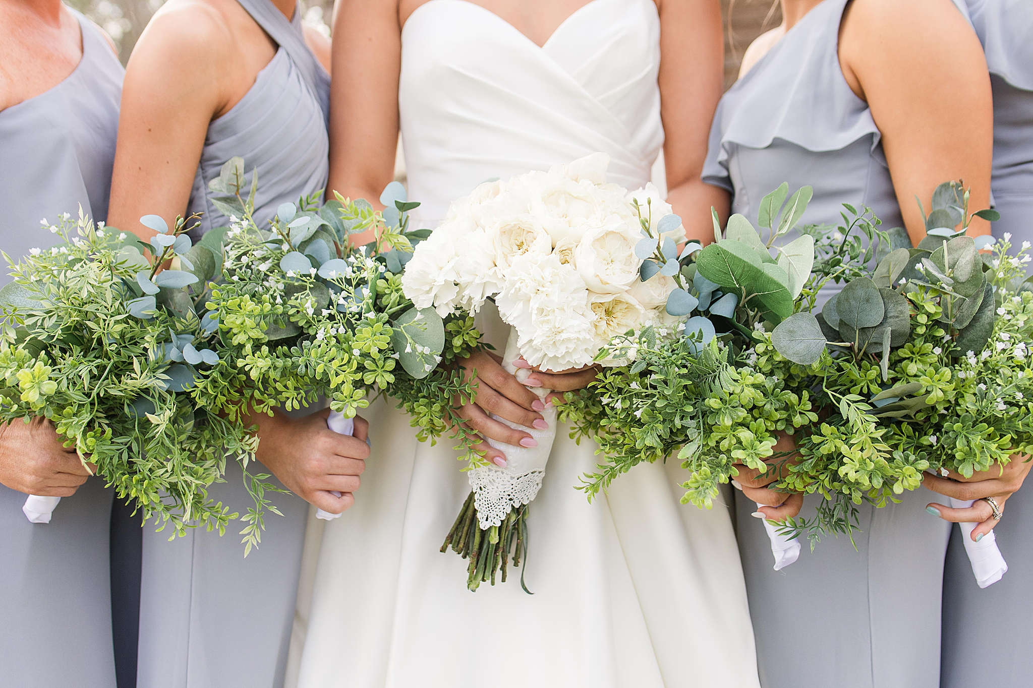 bridesmaids hold bouquets before fall Izenstone wedding