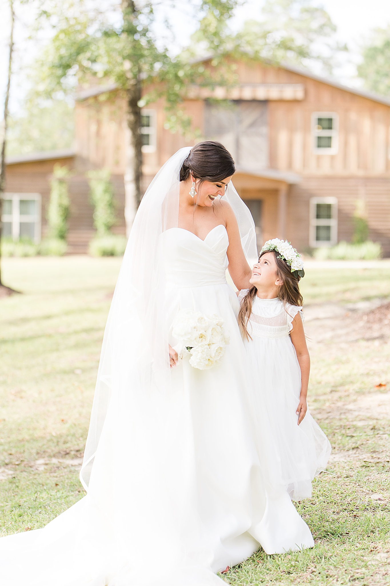 bride poses with flower girl