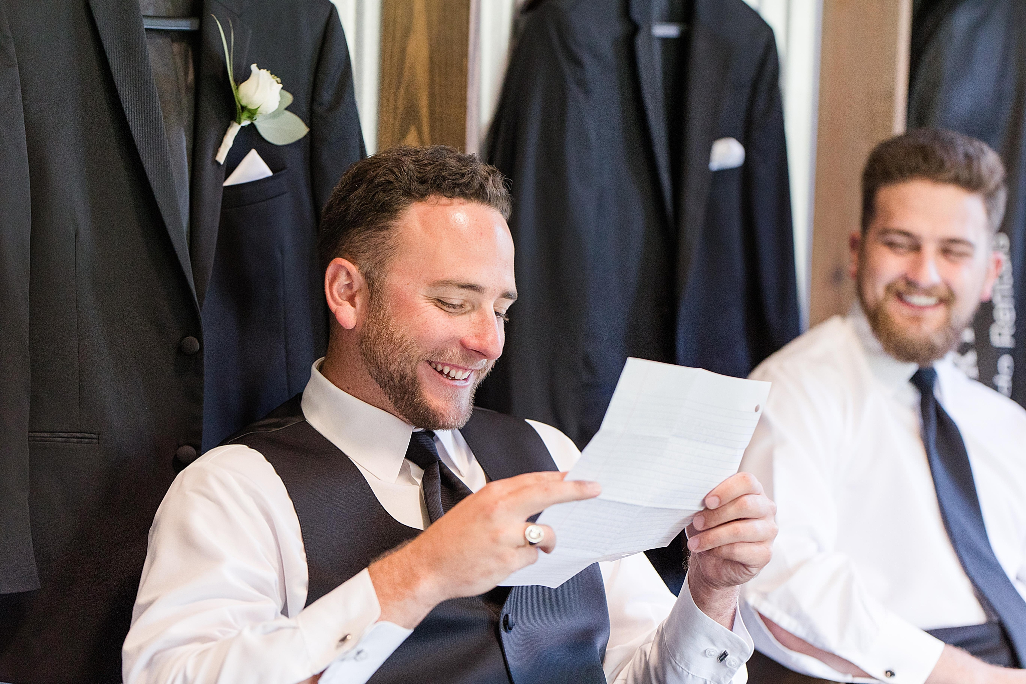 groom reads letter on wedding day