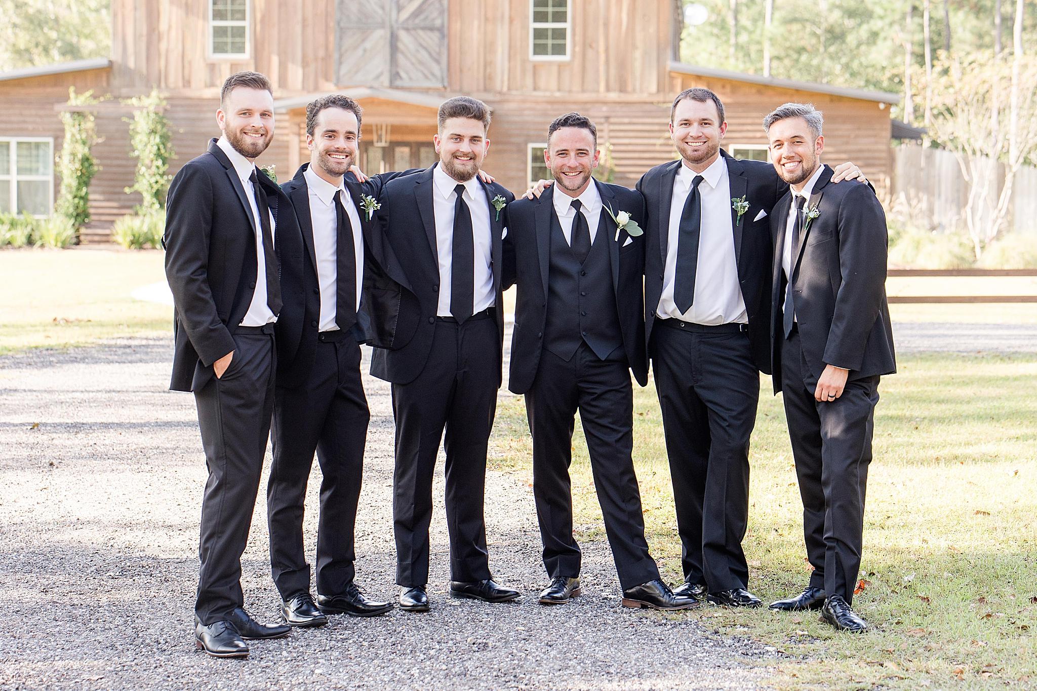 groom and groomsmen pose before Izenstone wedding