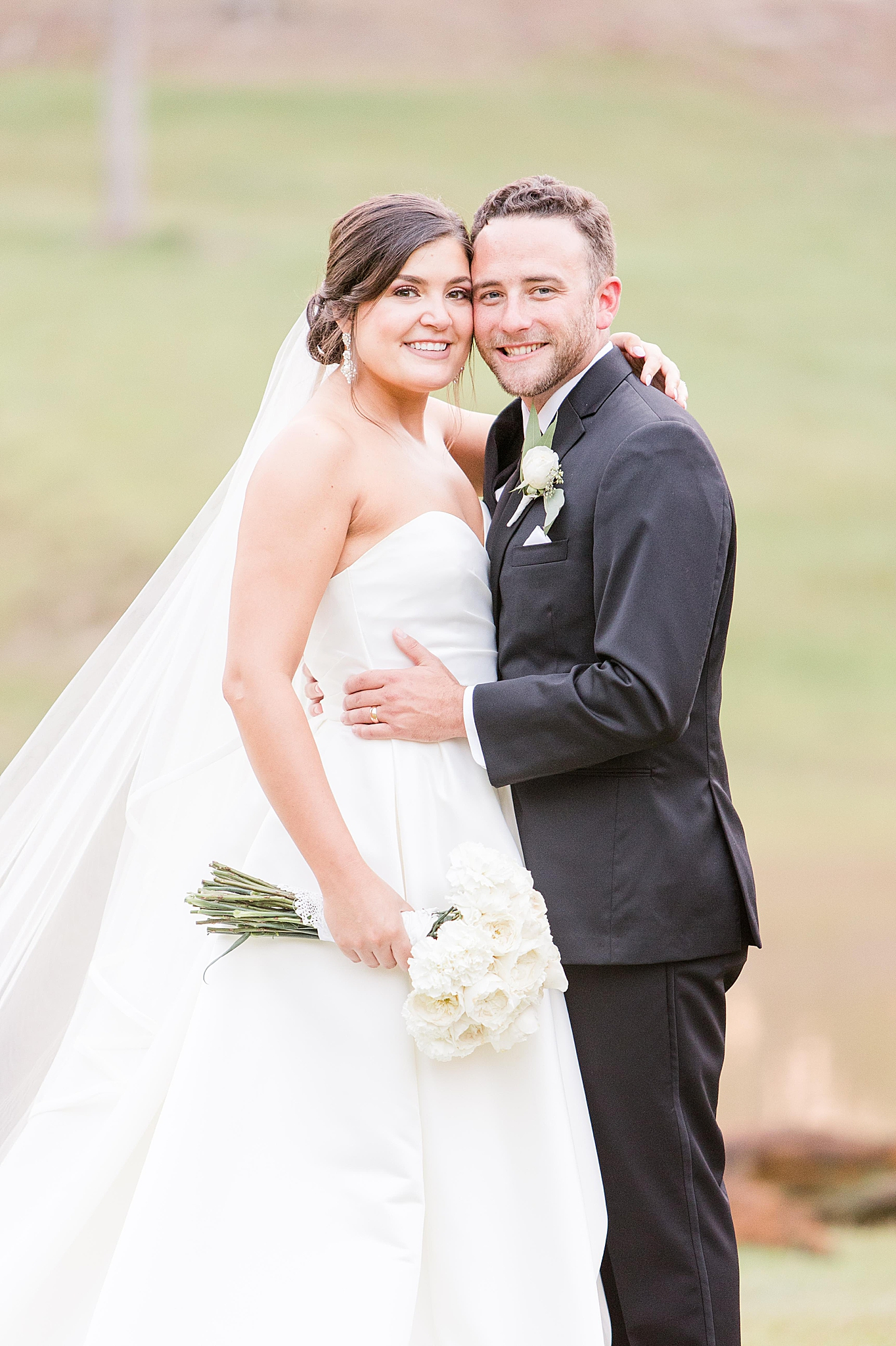 bride and groom pose at Izenstone