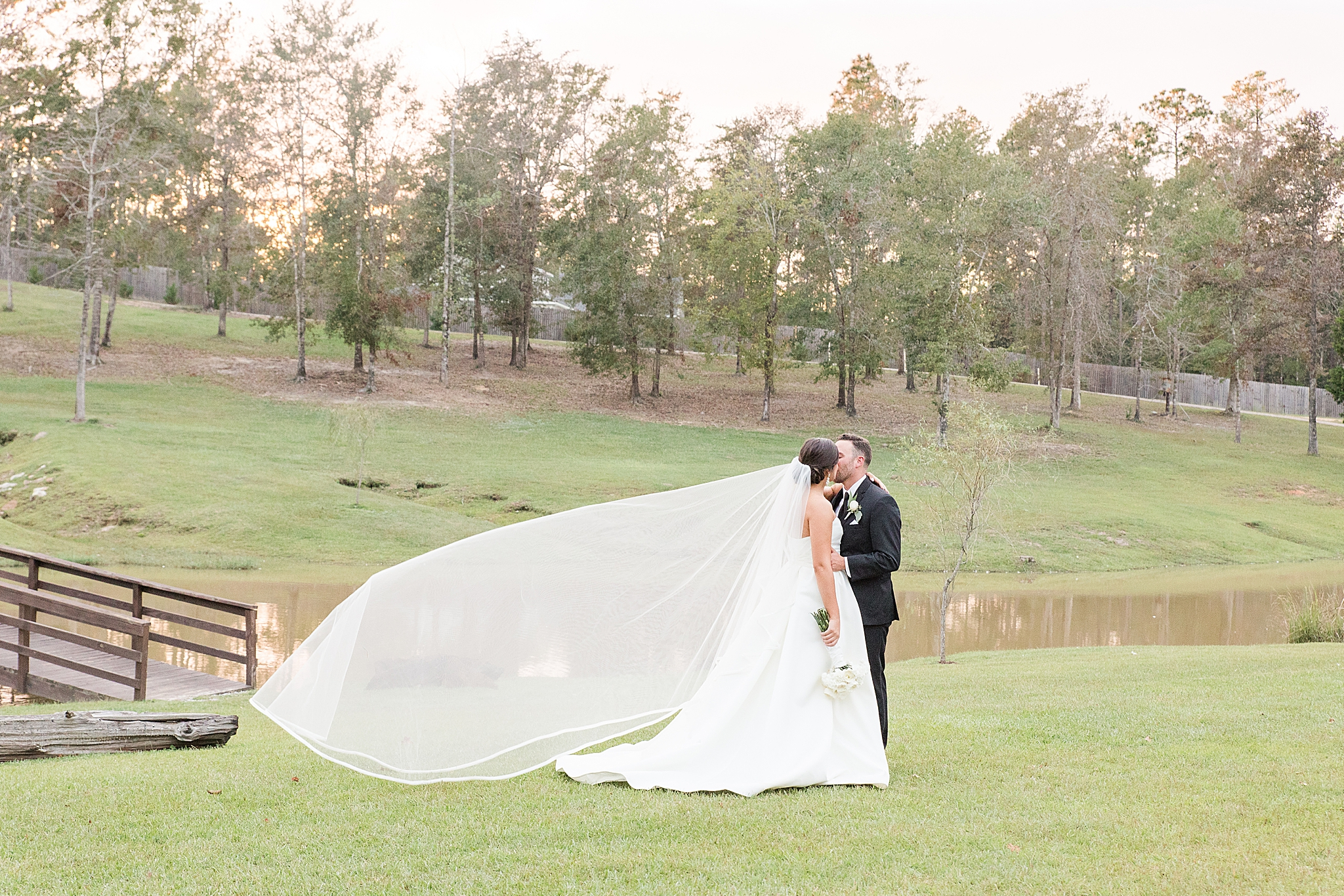 Izenstone wedding portraits at sunset with bride's veil floating