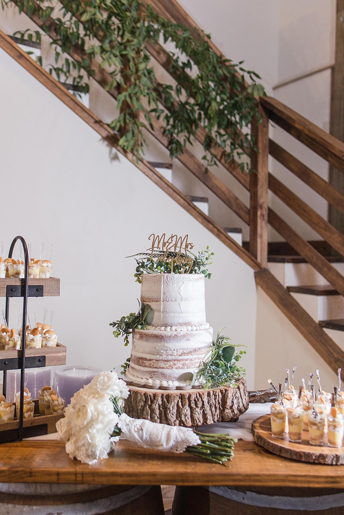 naked wedding cake on wood slice