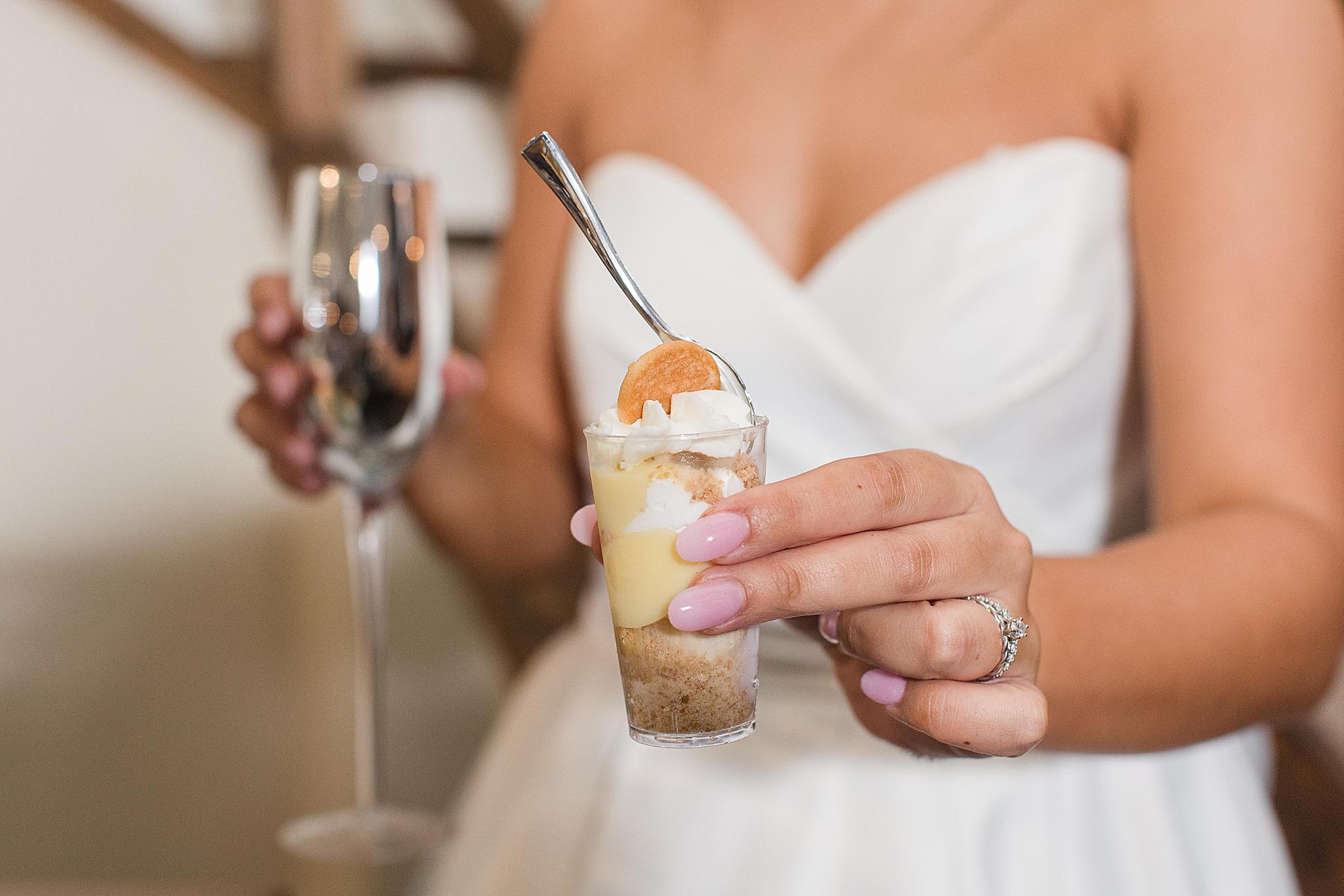 bride shows off mini desserts