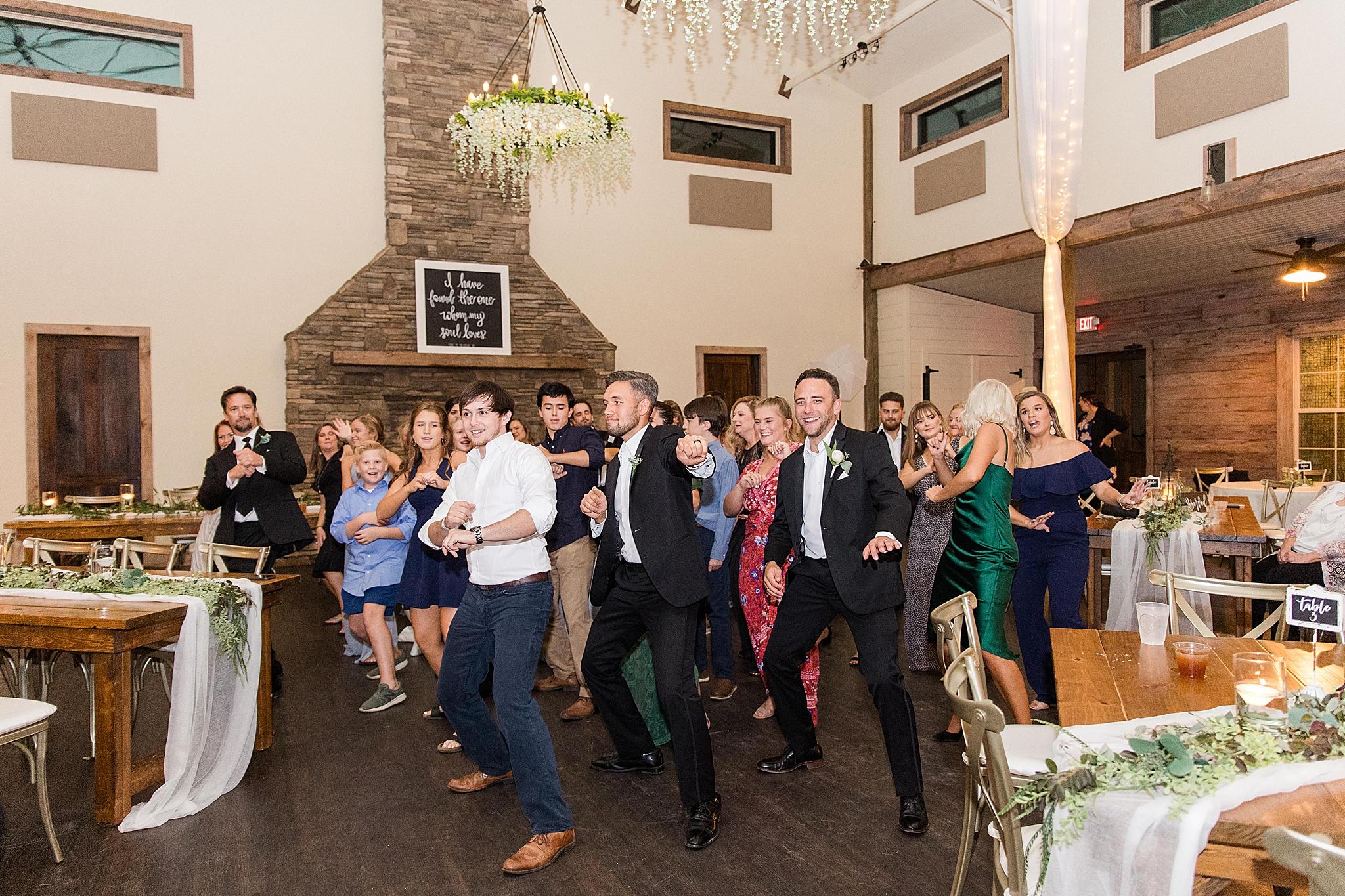 wedding guests dance during AL wedding reception