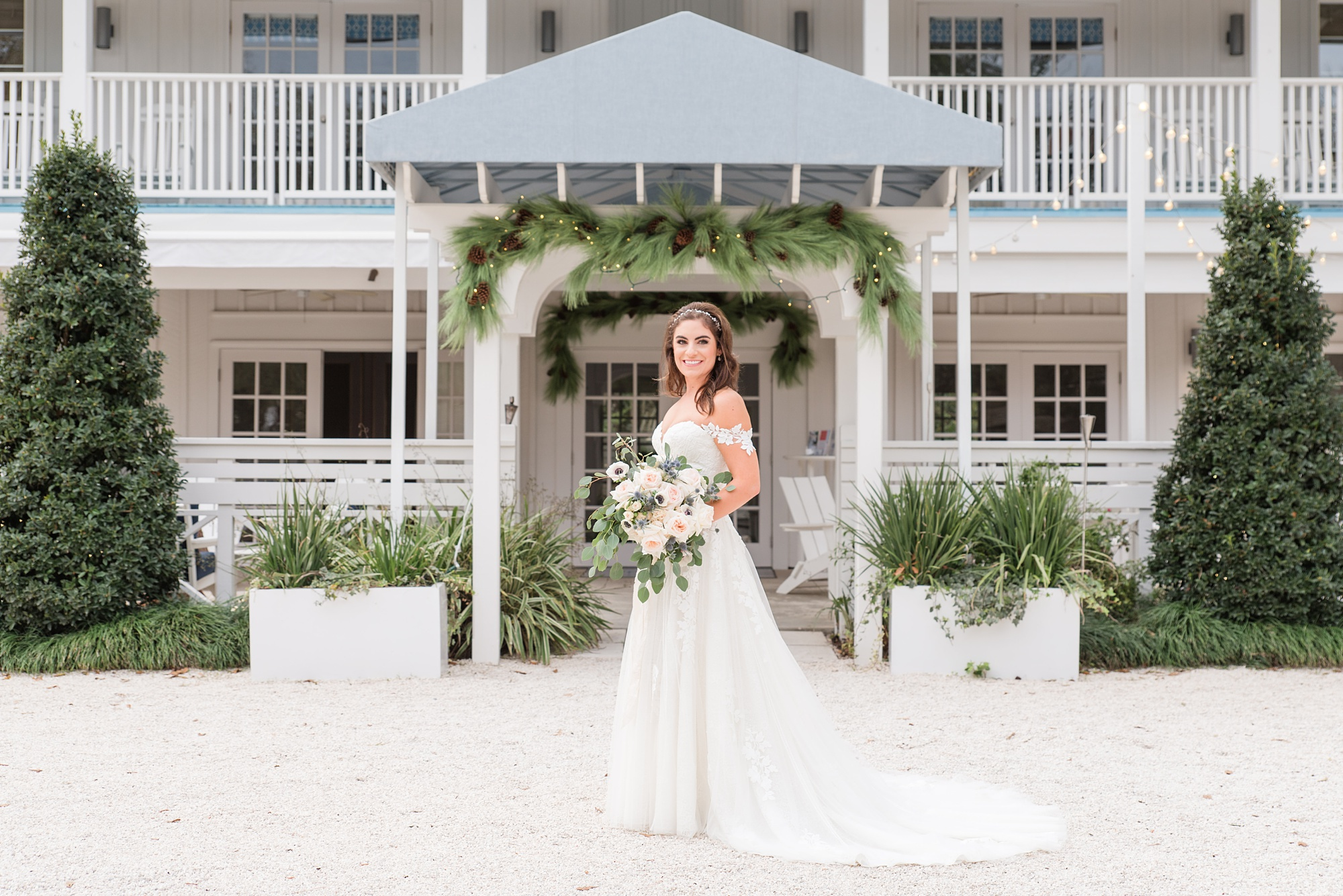 bride poses in front of Alabama venue for bridal portraits