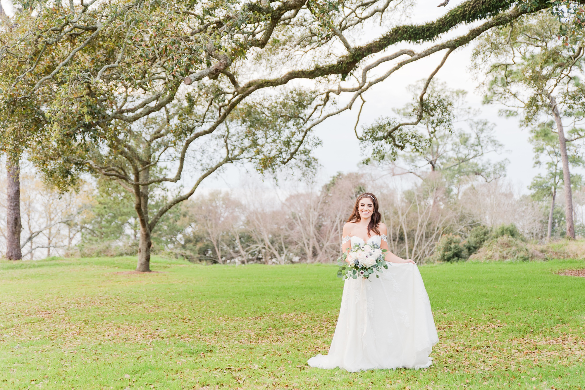 bride twirls dress during Little Point Clear bridal session