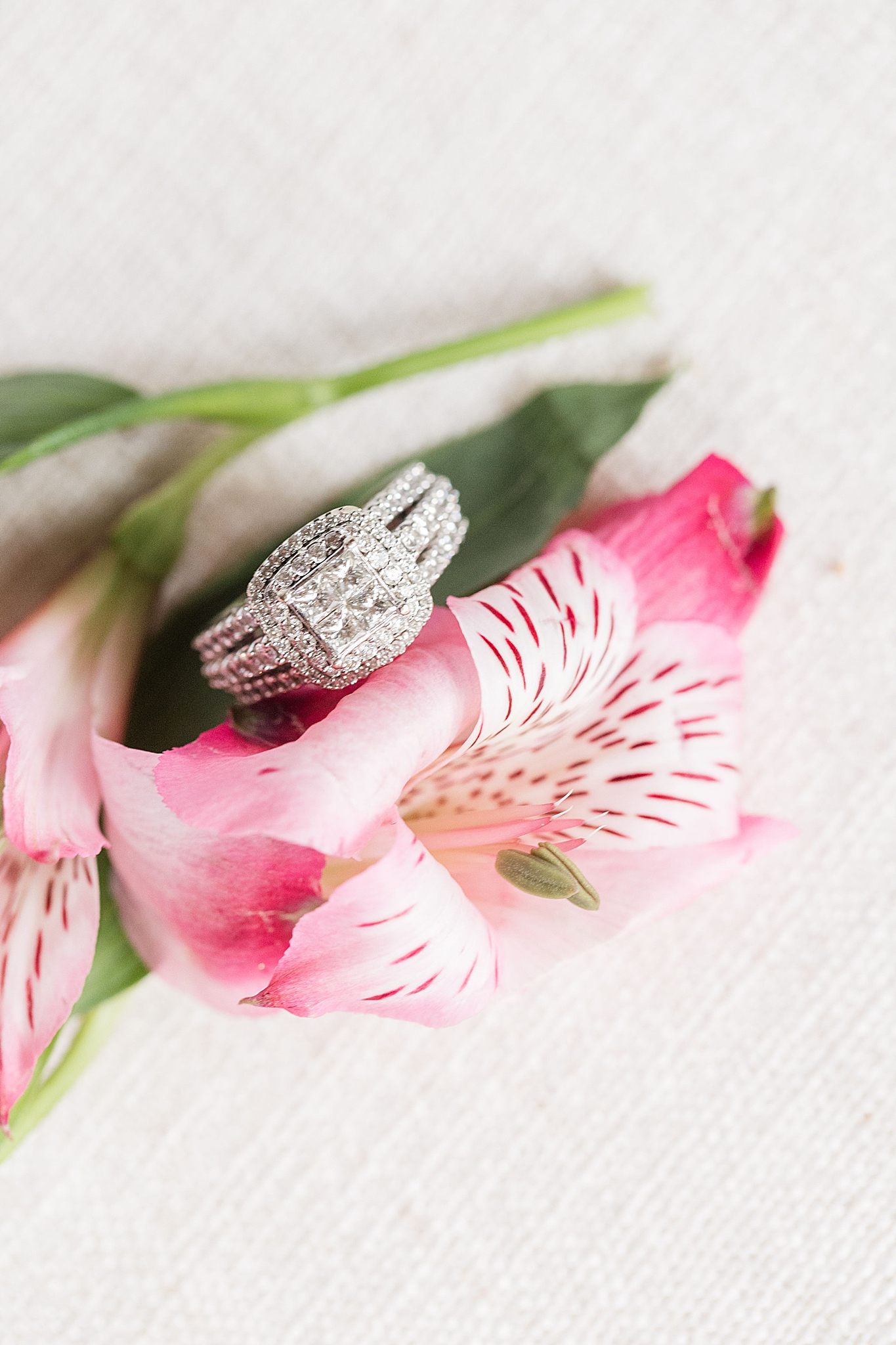wedding rings on pink lily for the bride