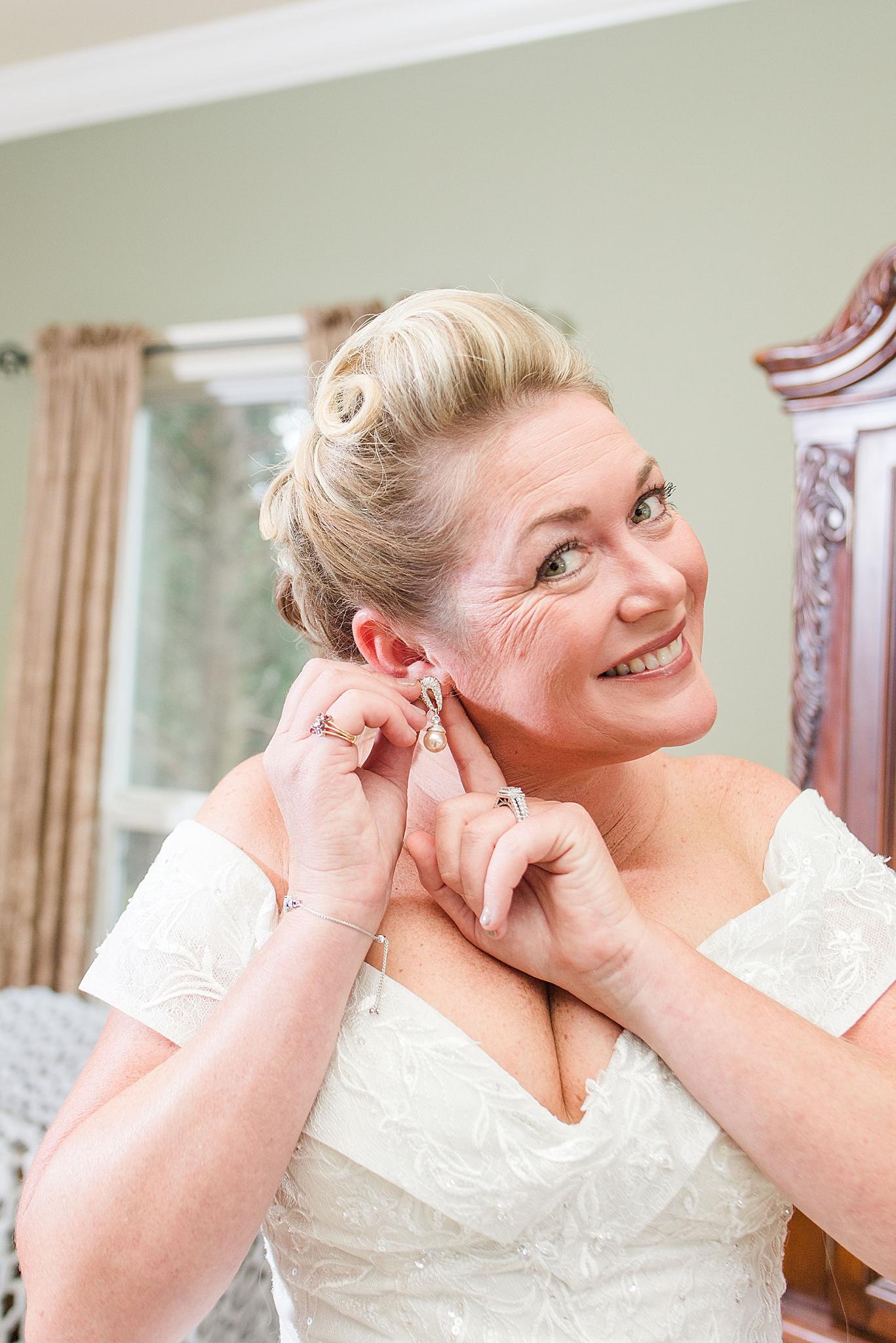 Alabama bride adjusts earrings before AL wedding