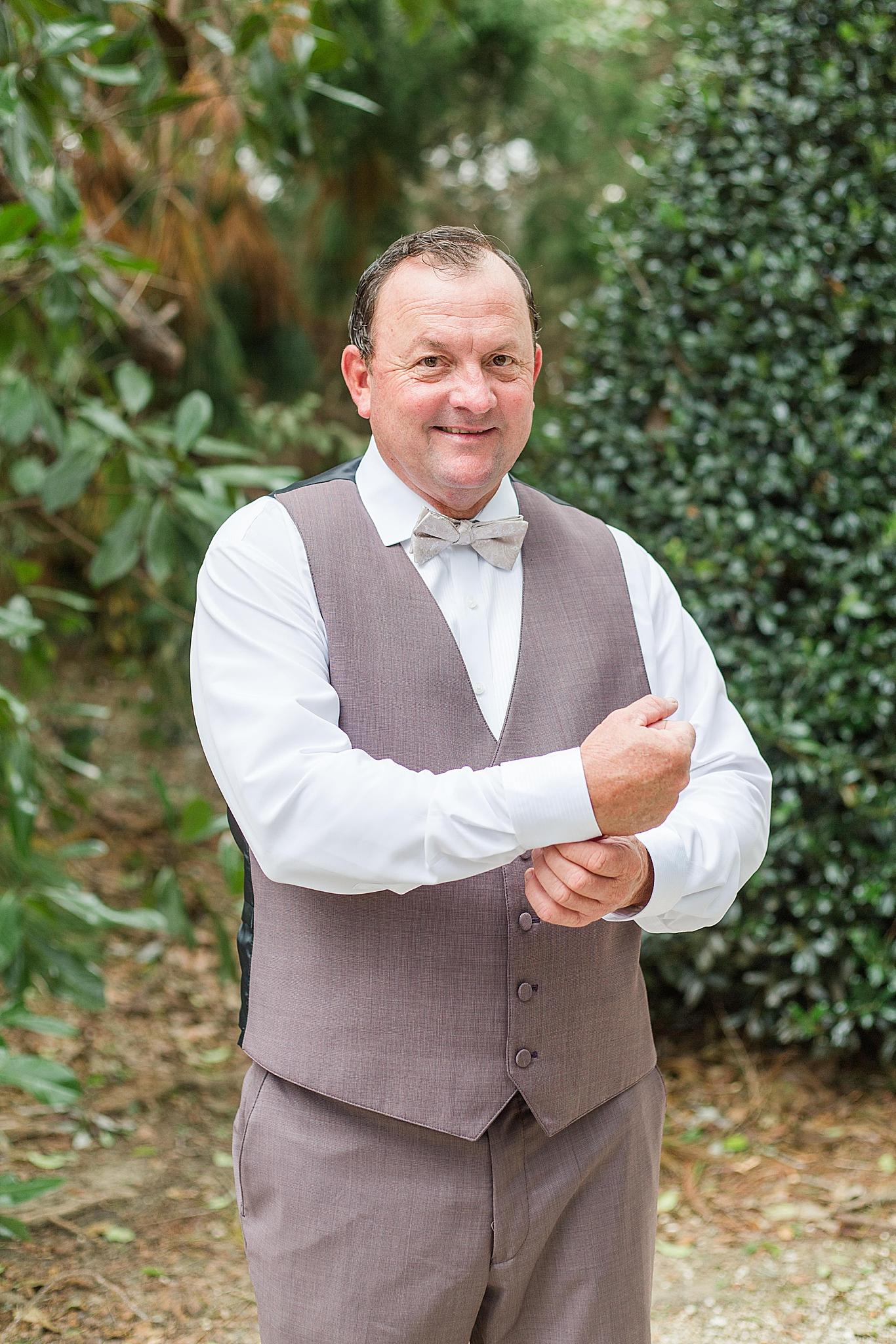 groom prepares for Bella Sera Gardens wedding