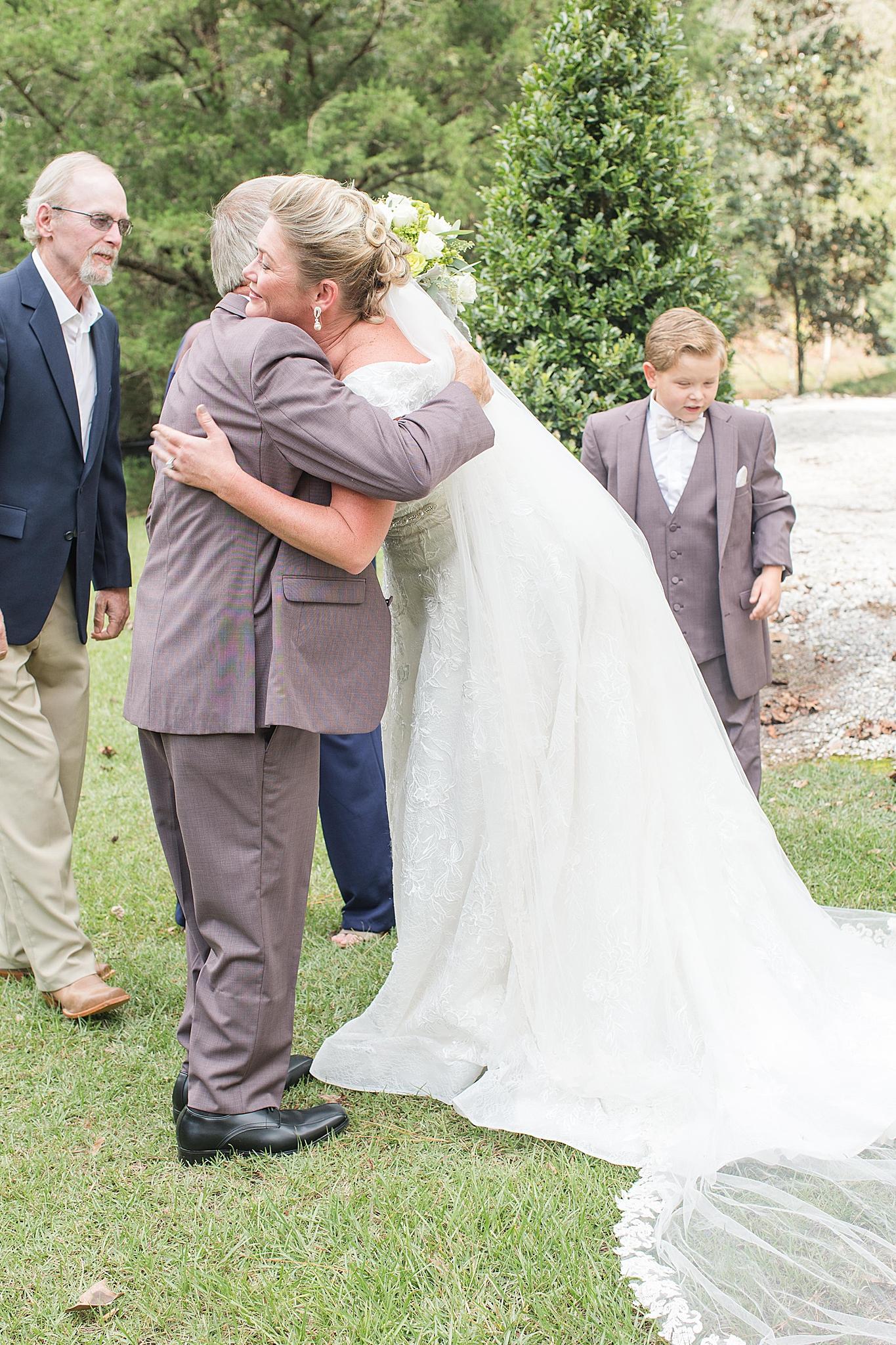 bride hugs dad after first look in Loxley AL