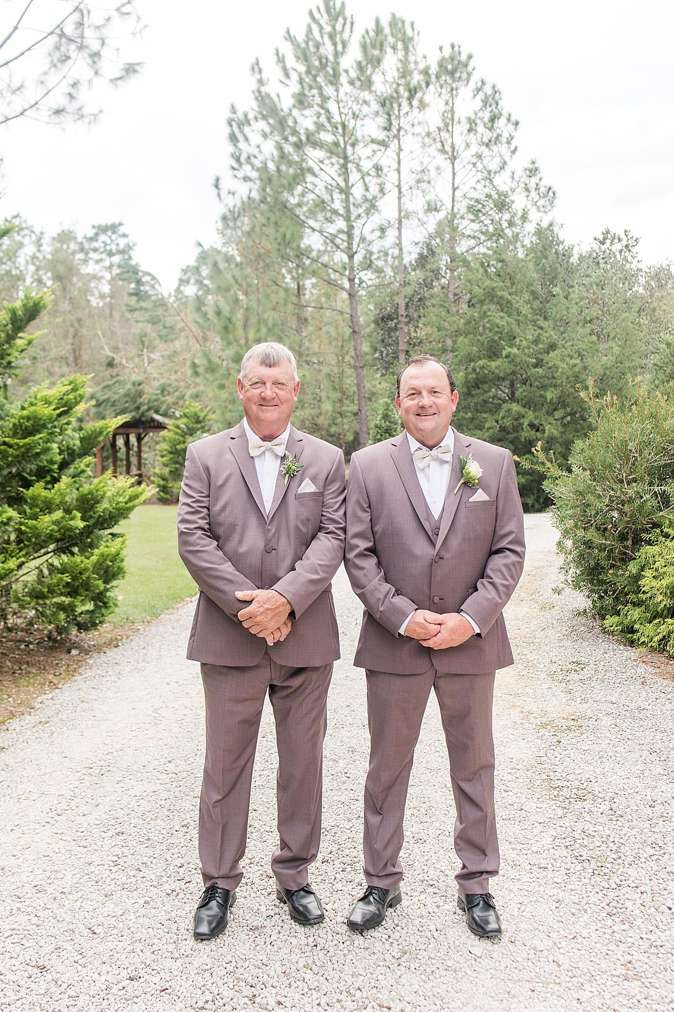 groom poses with groomsman before Alabama wedding