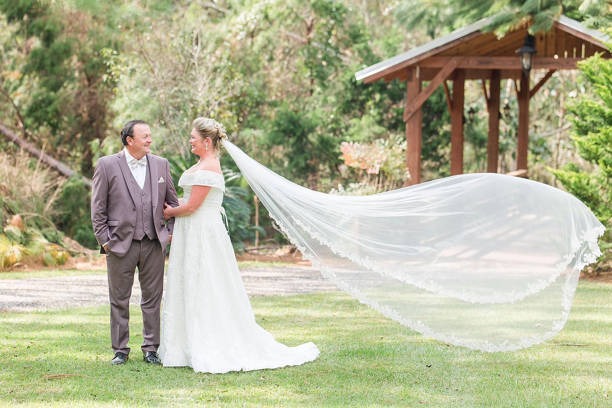 newlyweds pose outside Bella Sera Gardens