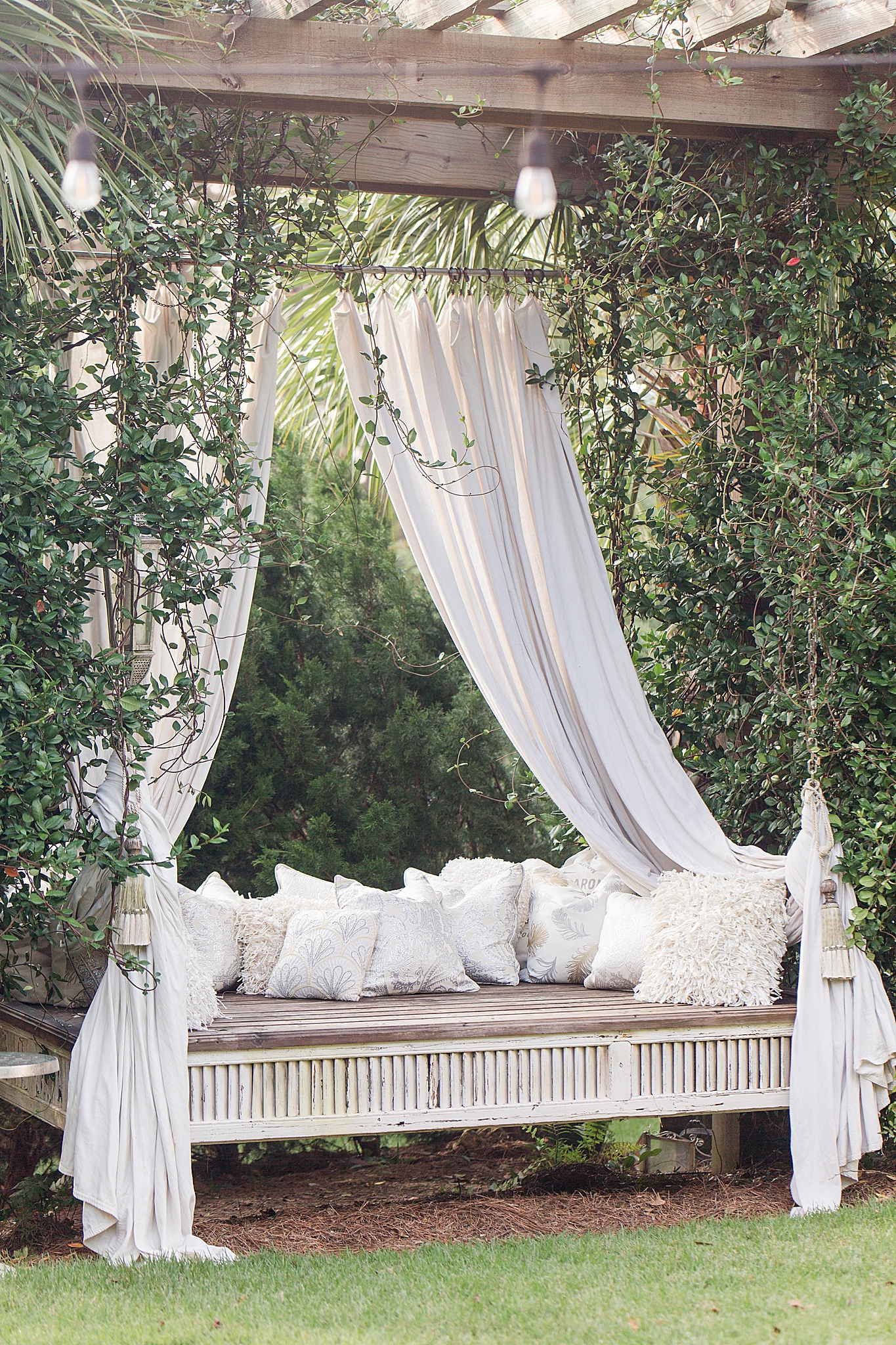 romantic seating with hanging curtains in Loxley AL wedding venue