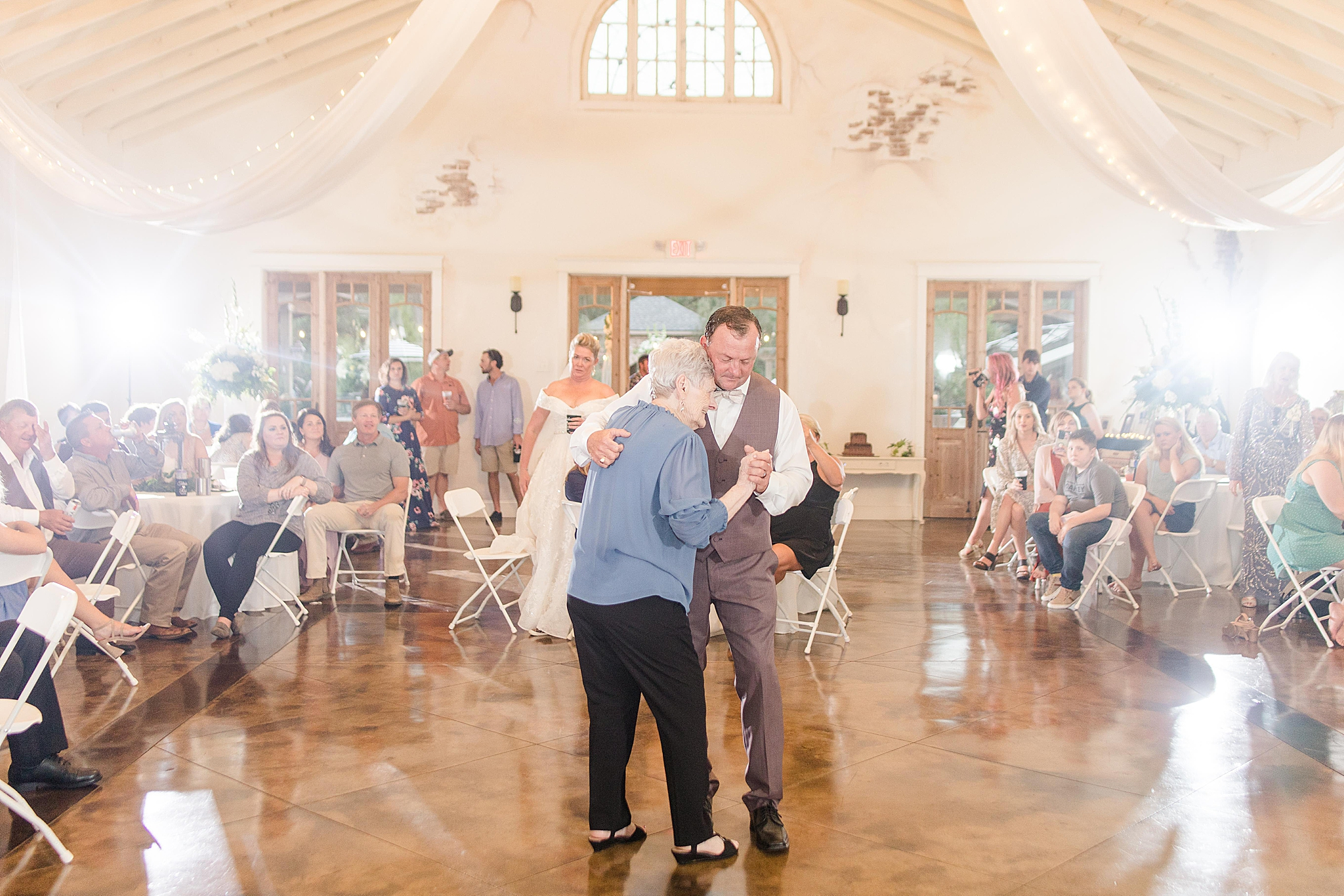 groom and mom dance during Loxley AL wedding reception