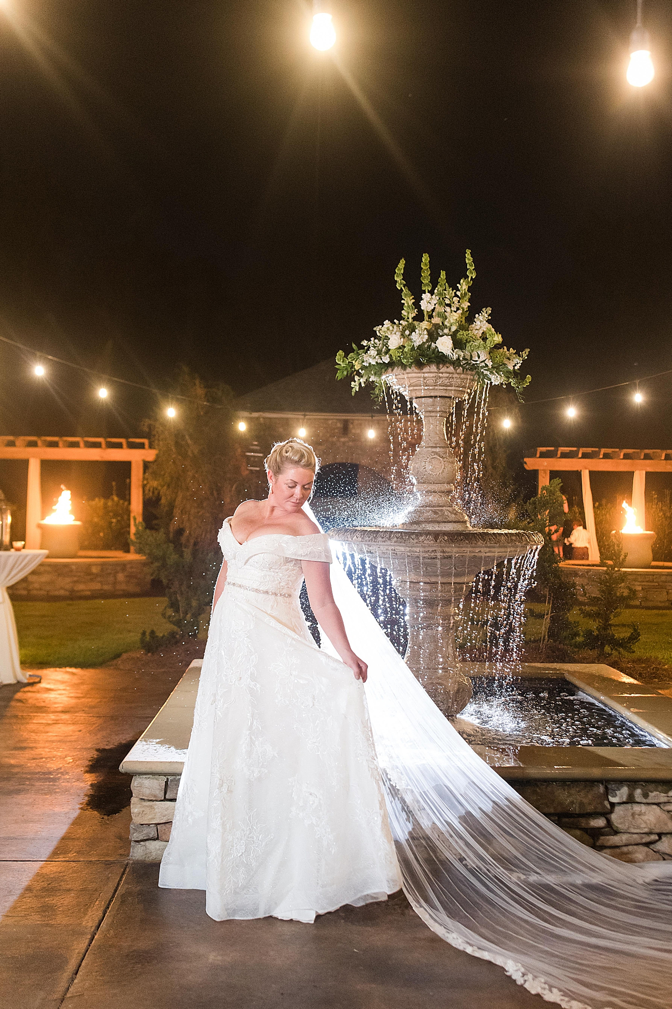 nighttime bridal portraits in courtyard at Bella Sera Gardens