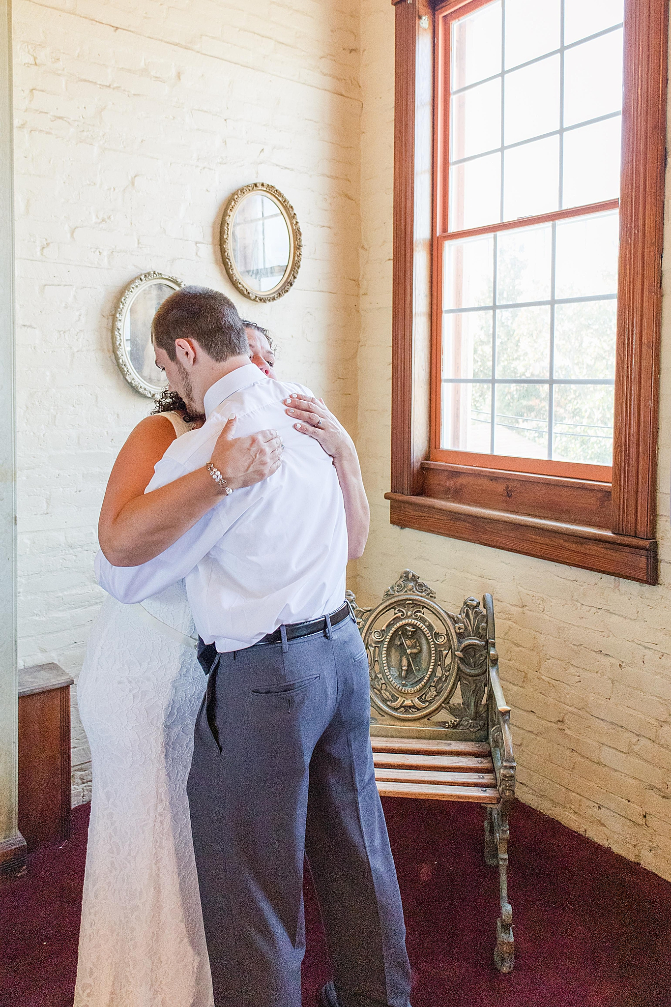 bride has first look with son before Florida wedding