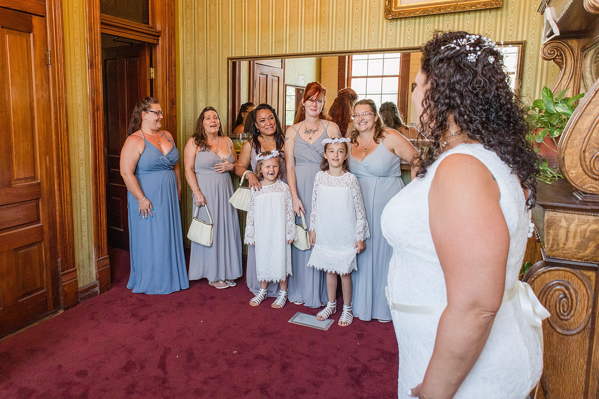 bride has first look with bridesmaids