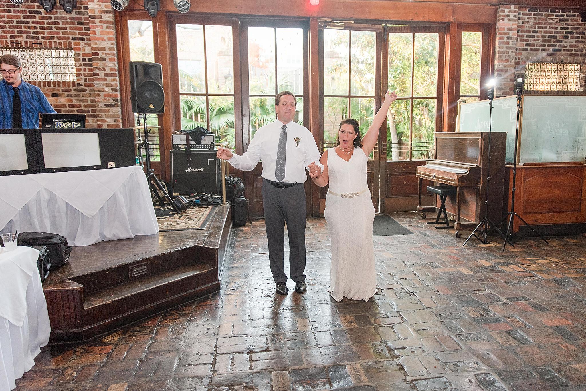 bride and groom enter Seville Quarter wedding reception