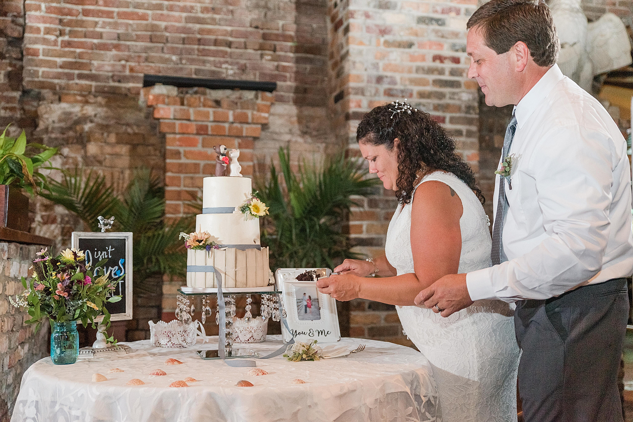 bride and groom cut the cake at Seville Quarter