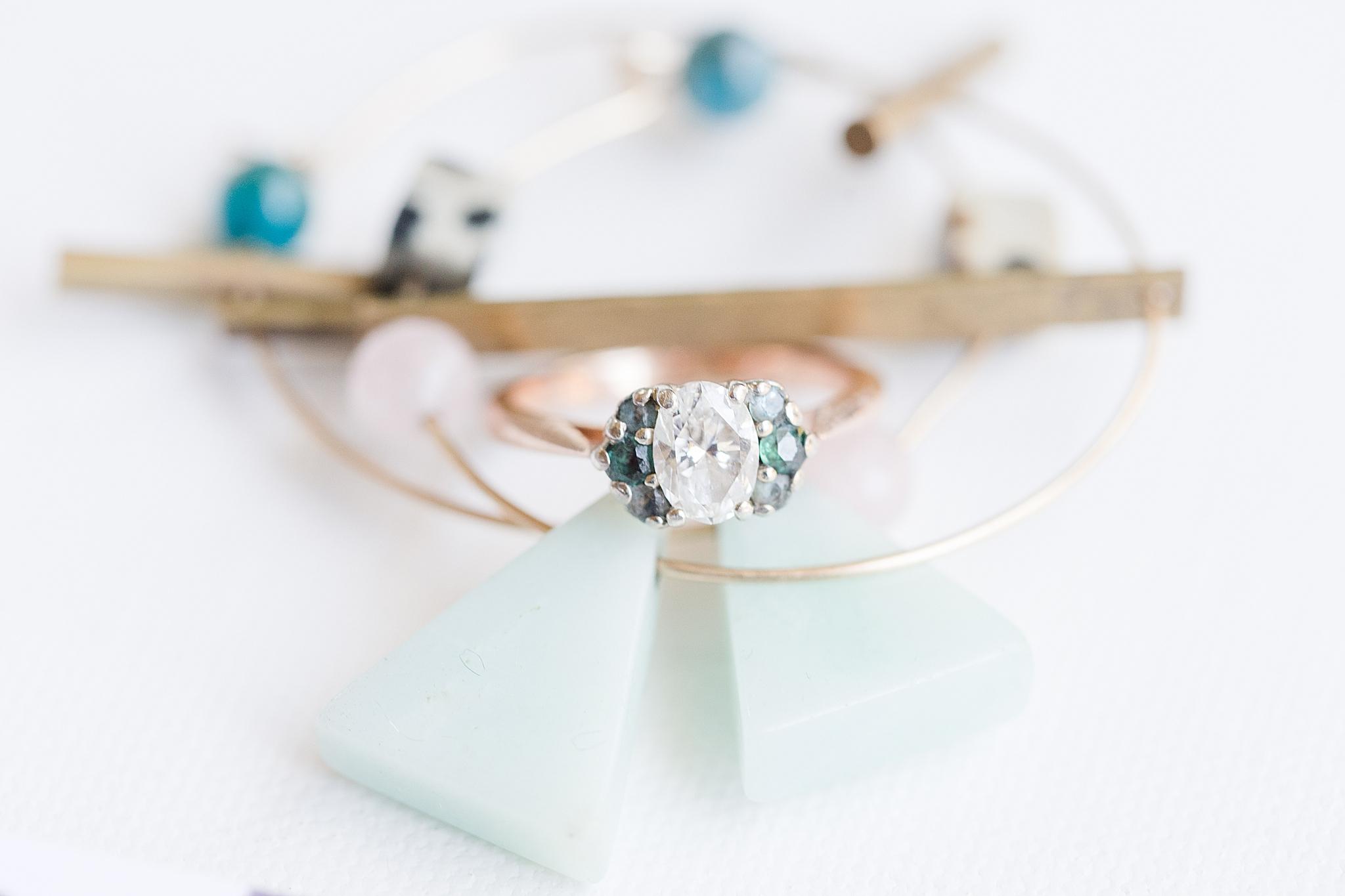wedding ring sits on bracelets