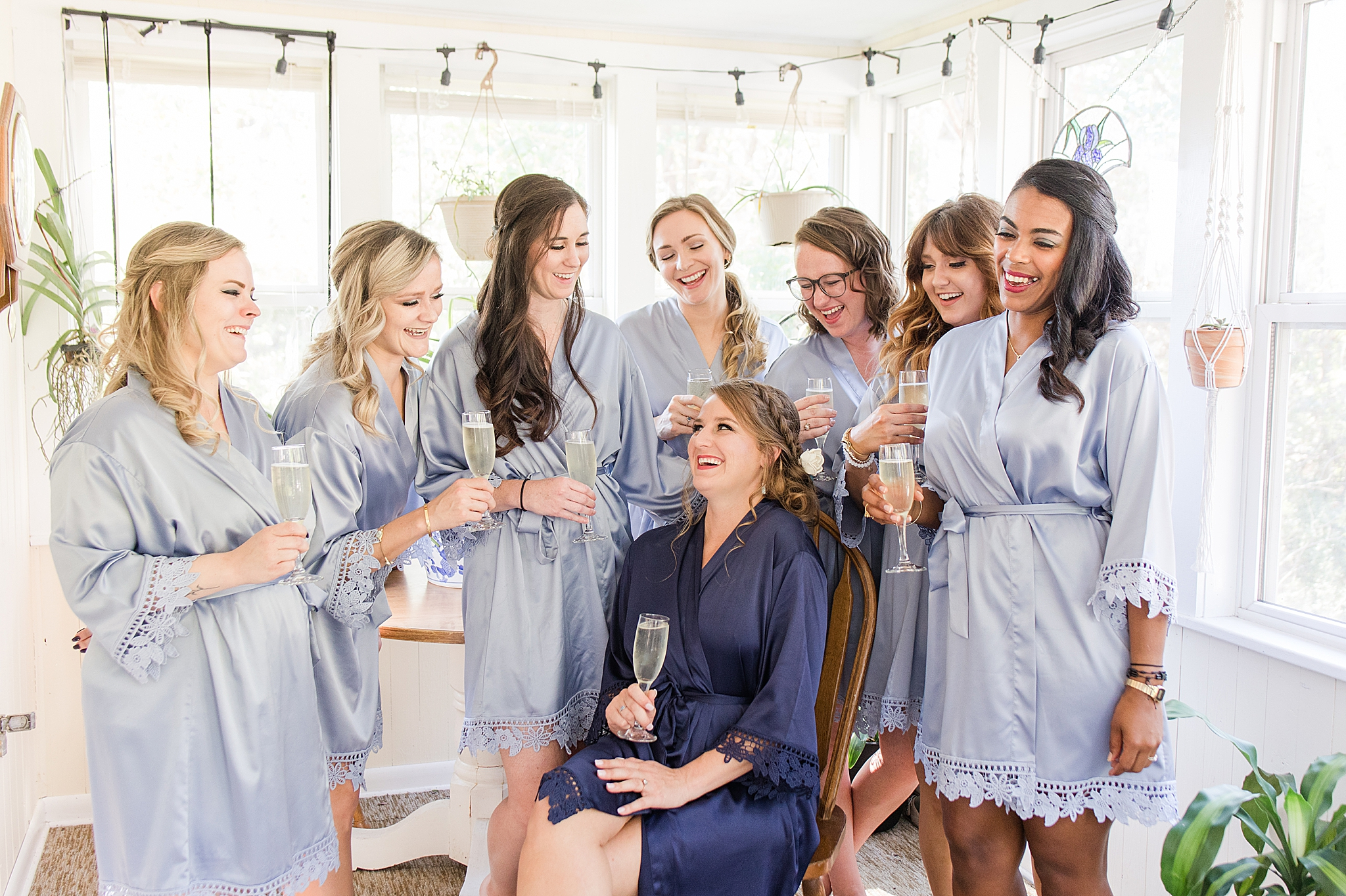 bride laughs with bridesmaids before Burkhardt Pond Wedding