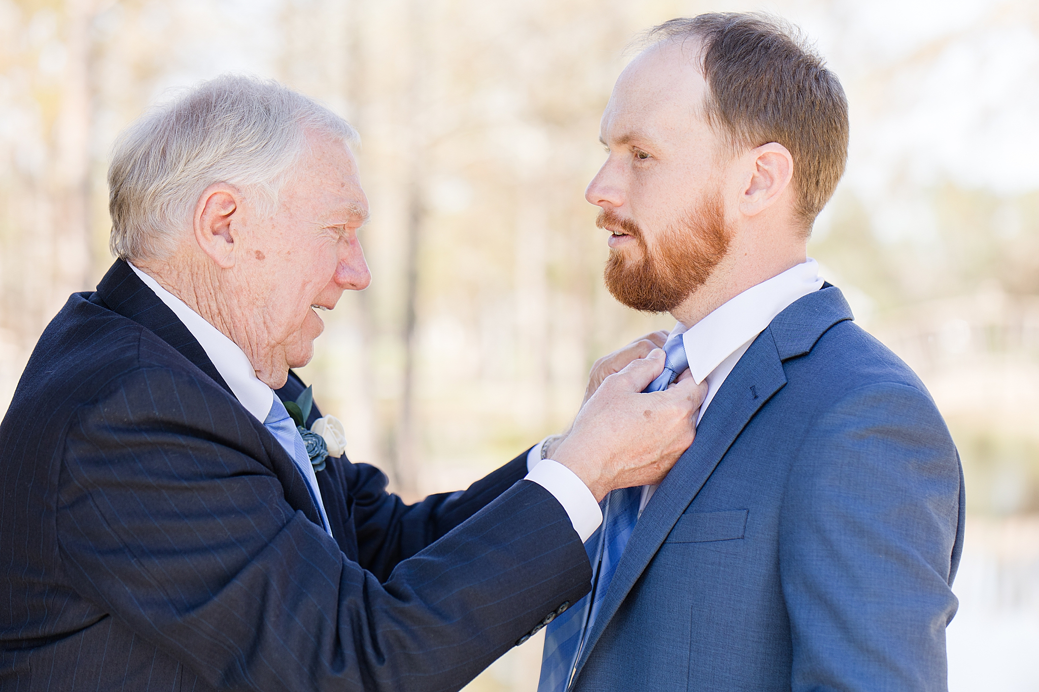 father of groom helps with tie