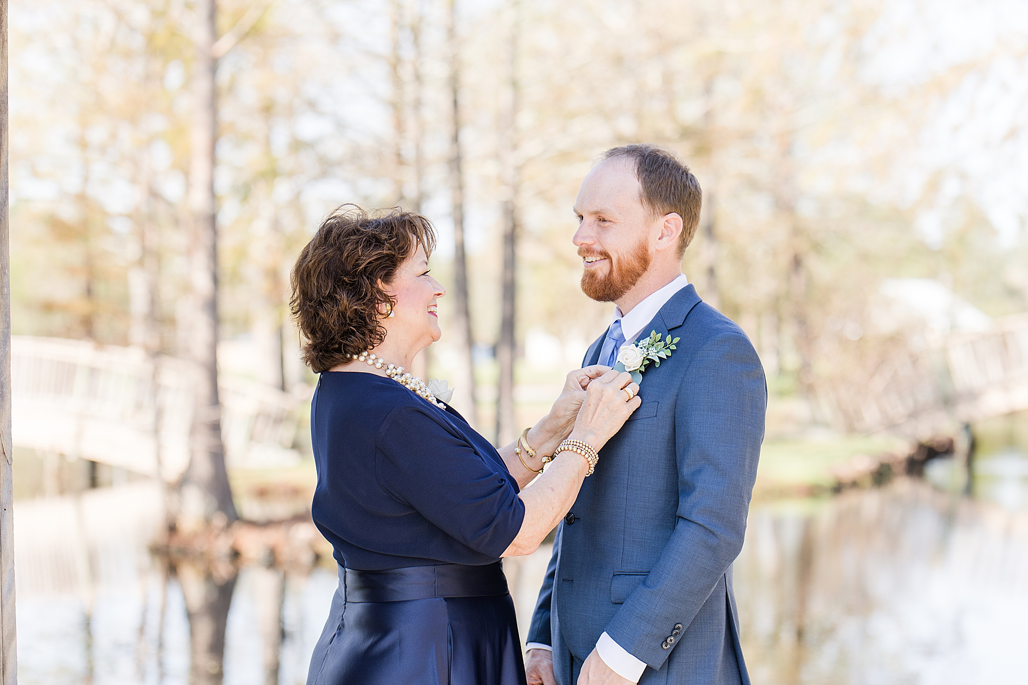 mother of groom helps with boutineere