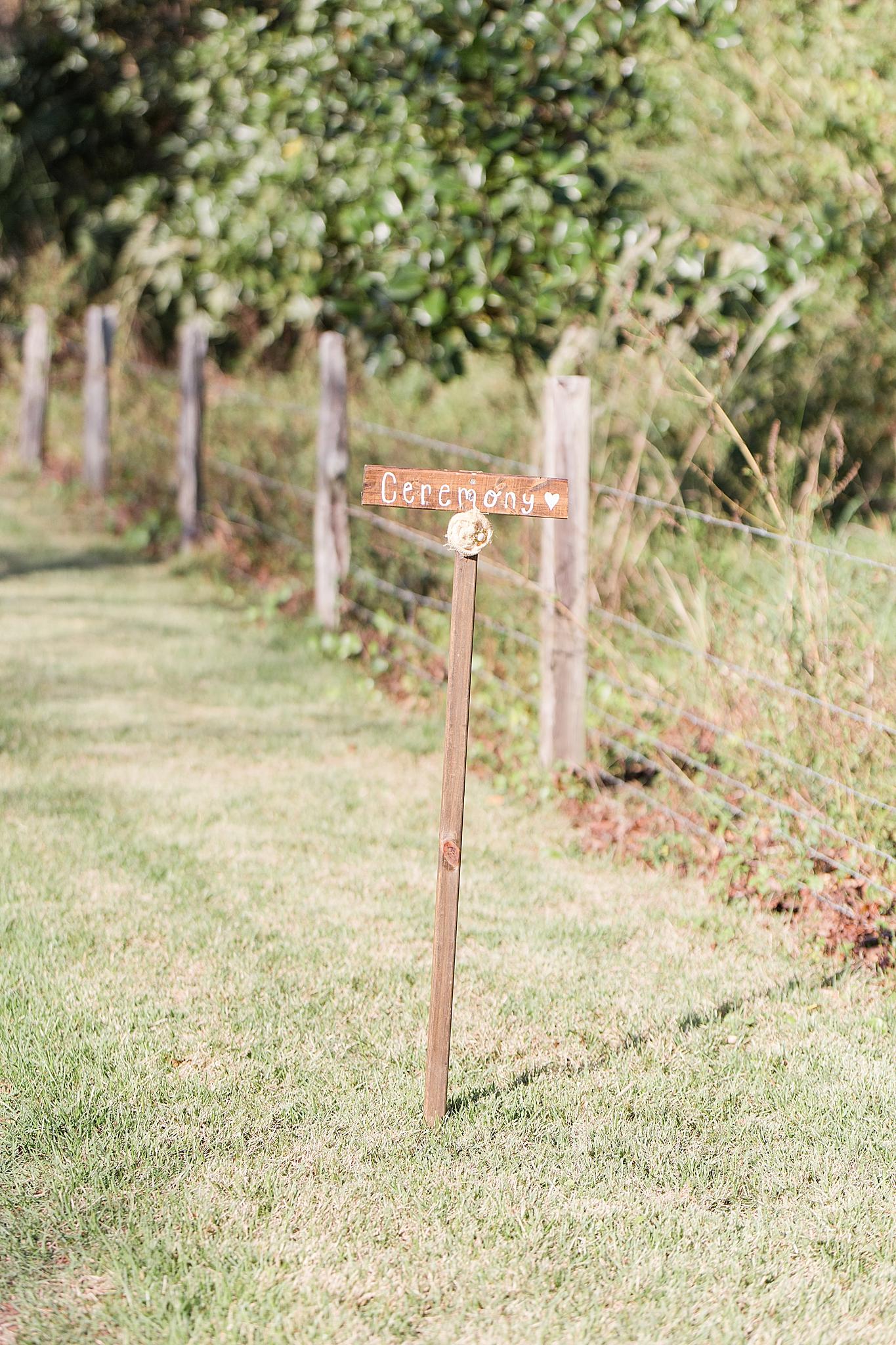 rustic ceremony sign at Burkhardt Pond