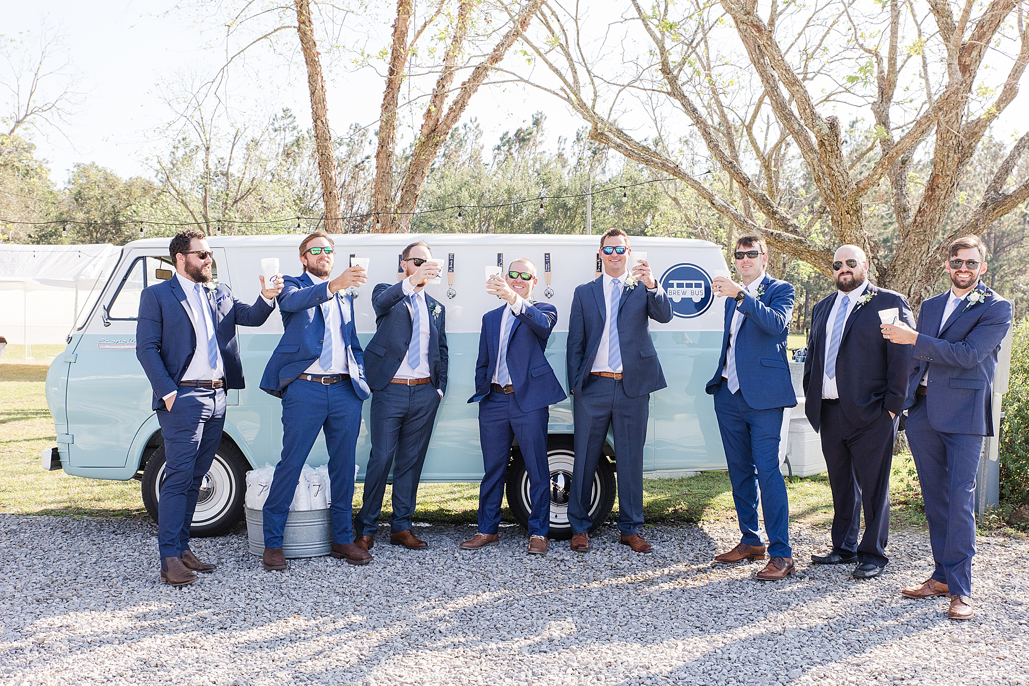 groom and groomsmen grab a drink from the Brew Bus