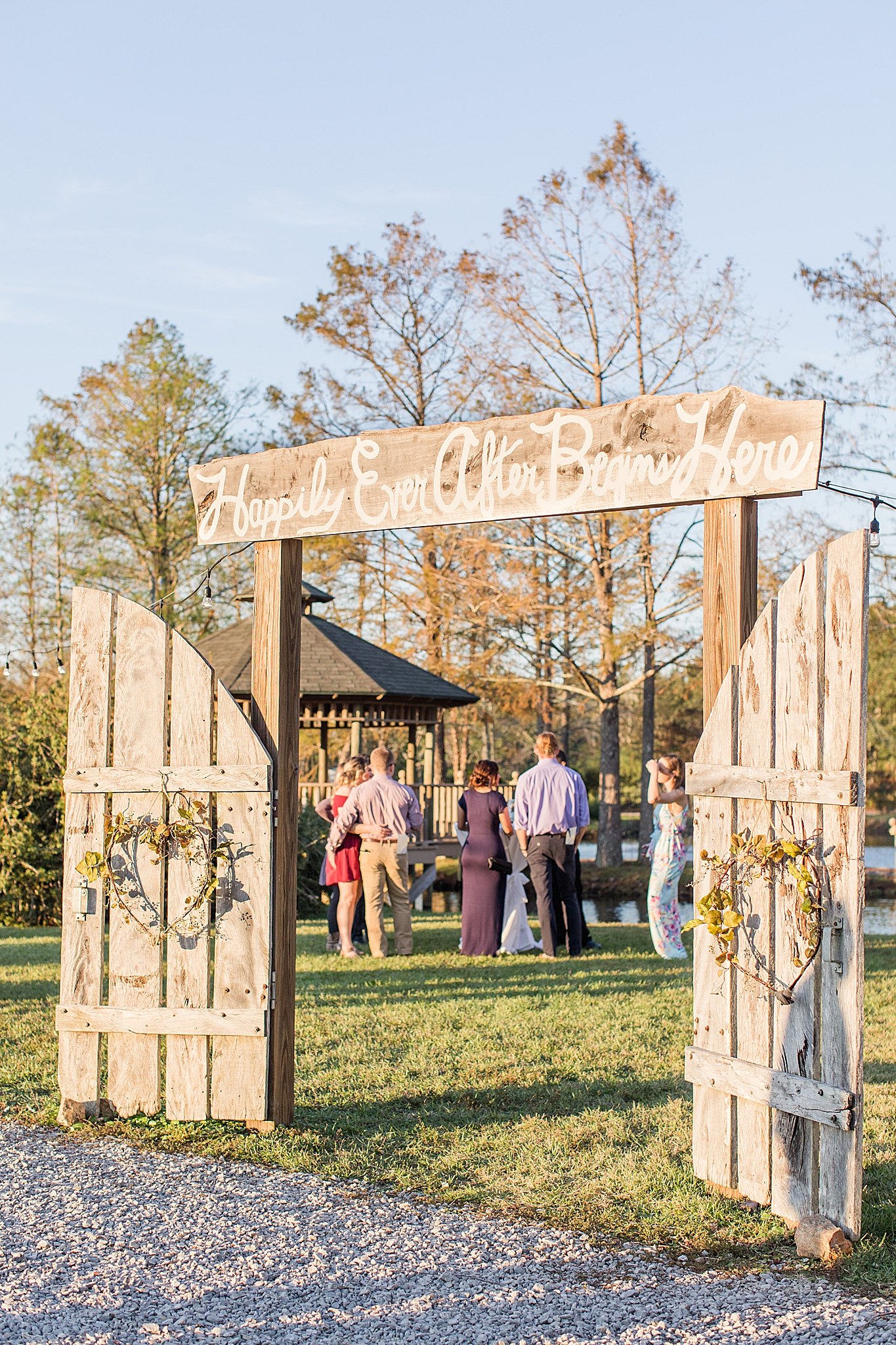 wooden gate opening at wedding reception