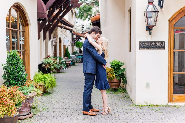bride and groom kiss on street in Alabama