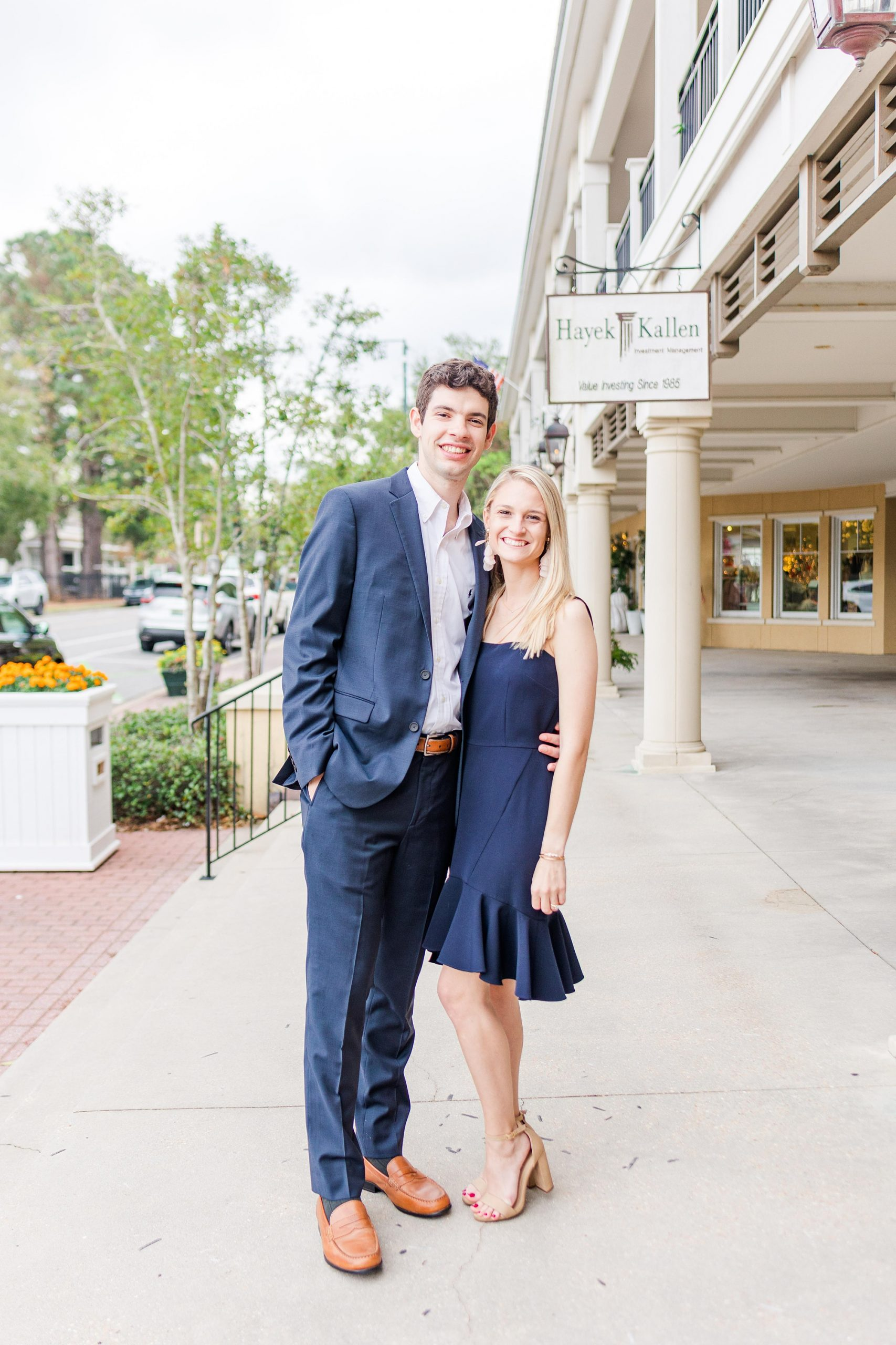 bride and groom pose on street in Alabama