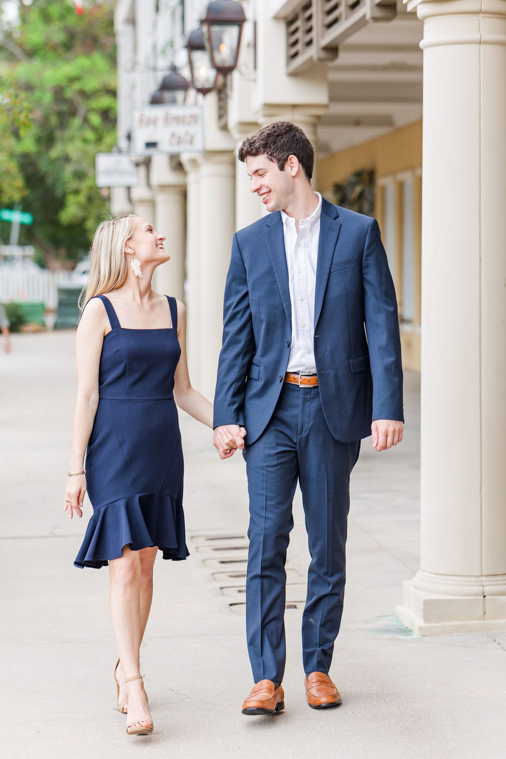 couple walks down street in Fairhope AL