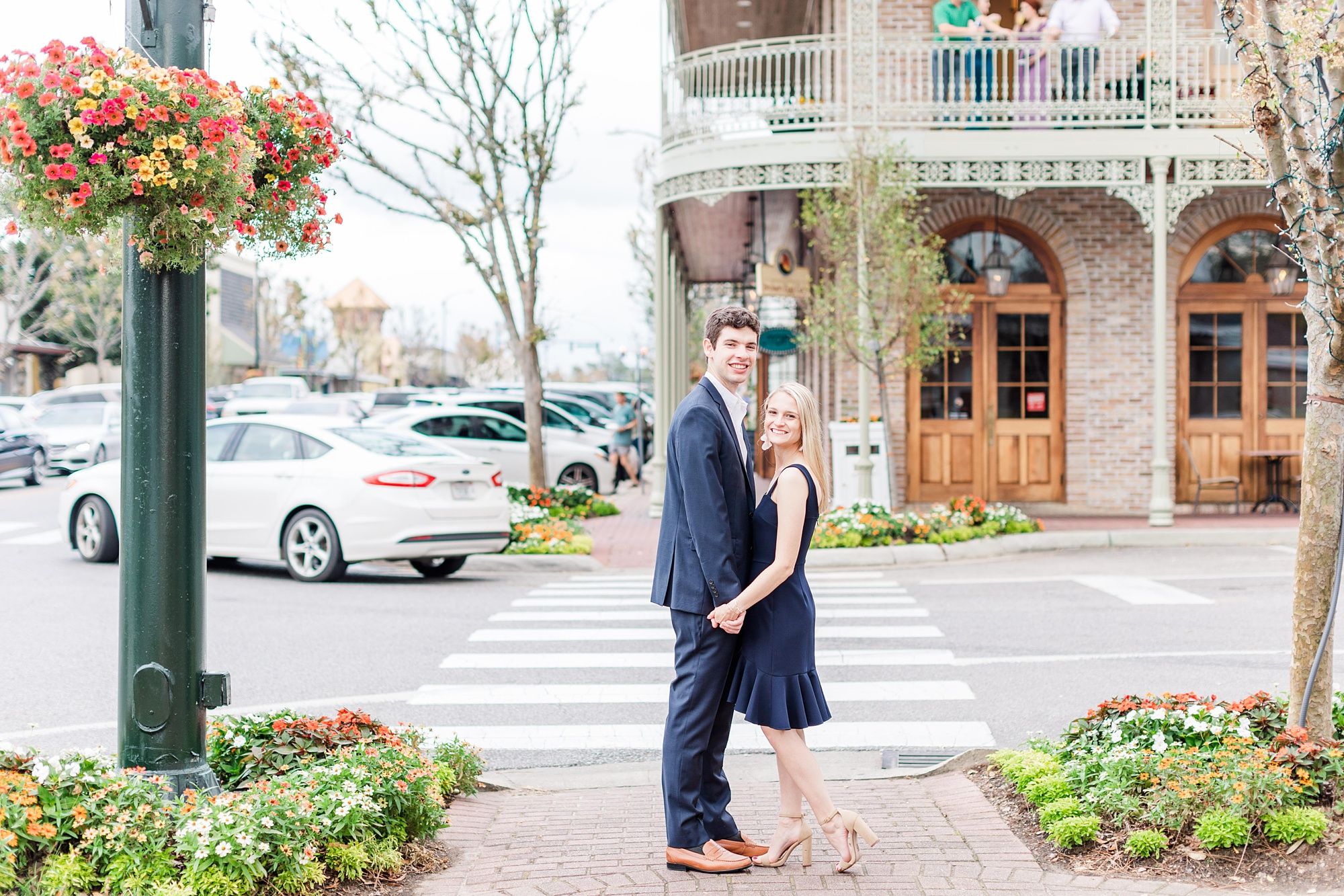 bride and groom pose by crosswalk in Alabama town