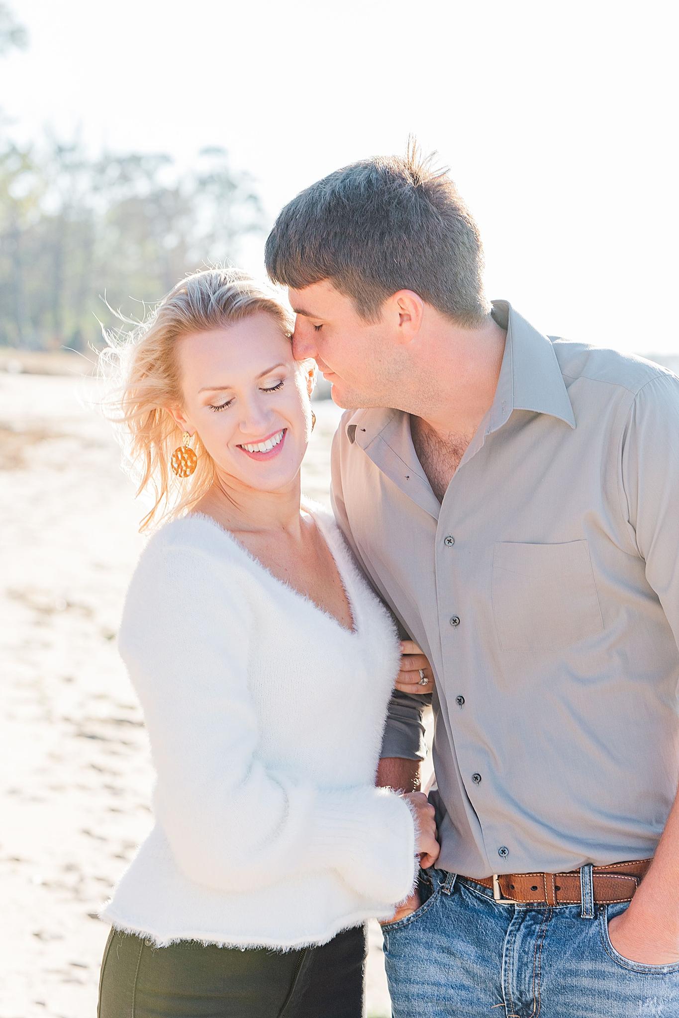 groom makes bride laugh during engagement photos in Fairhope AL