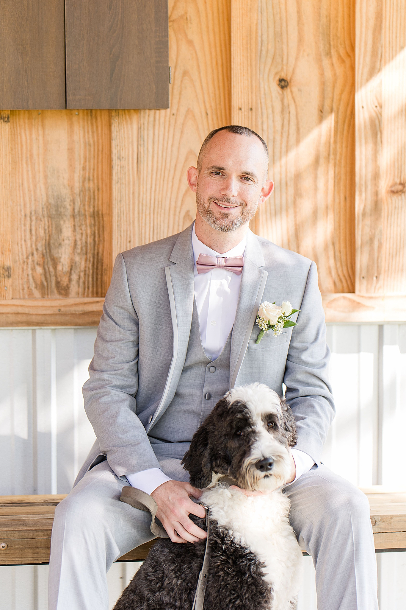 groom prepares for Alabama wedding with dog