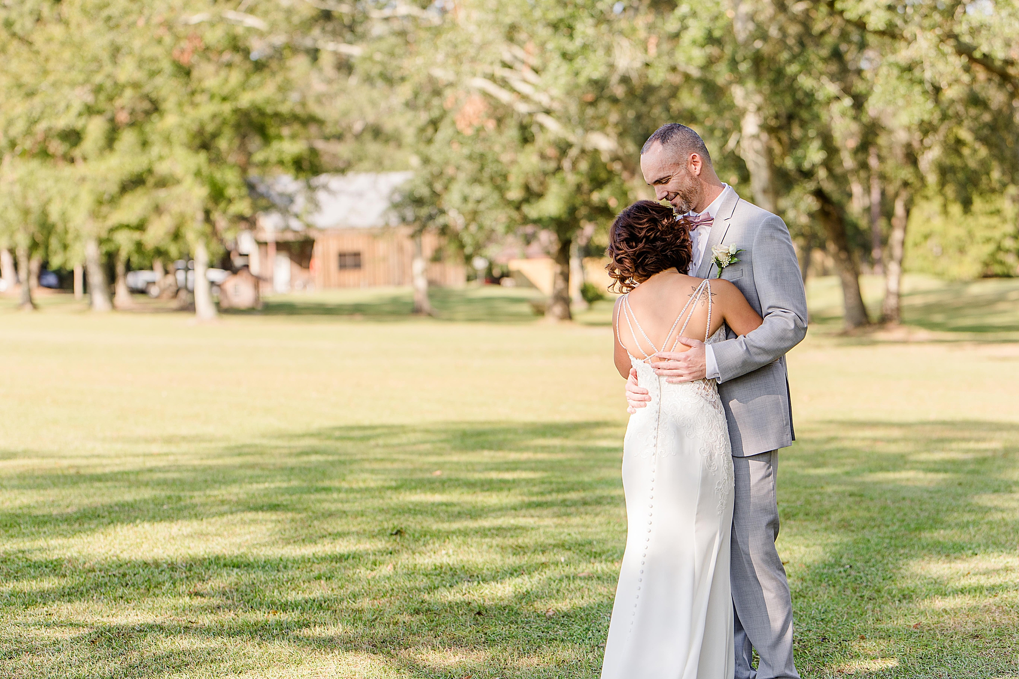 bride and groom hug during first look at The Orchard at Hayes Farm