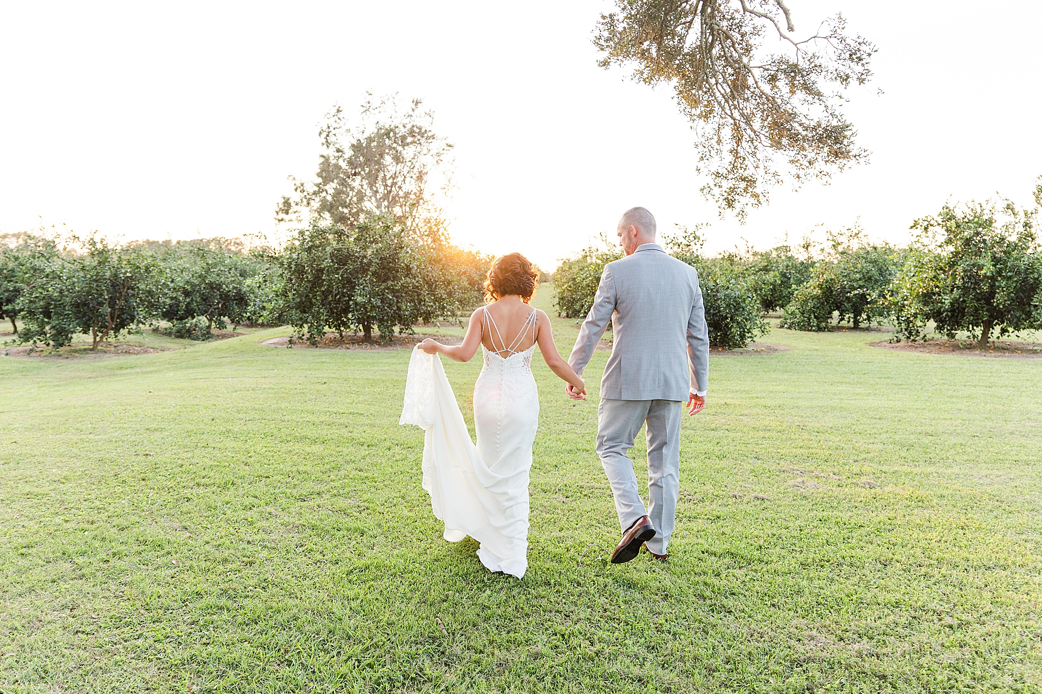 newlyweds walk away from ceremony at Orchard at Hayes Farm