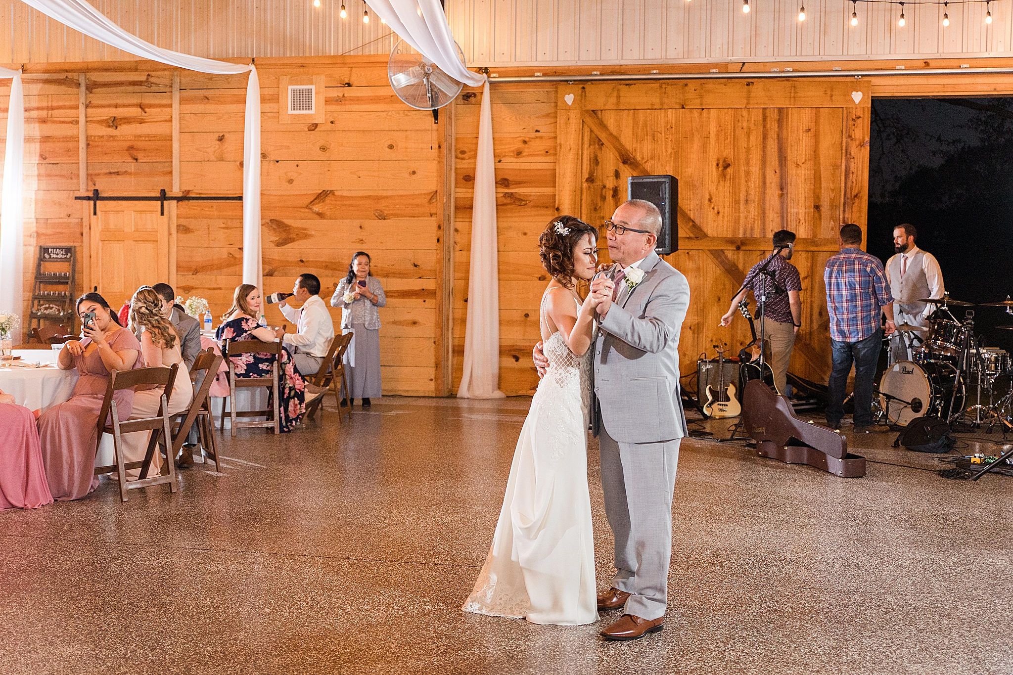 bride dances with father during Orchard at Hayes Farm reception