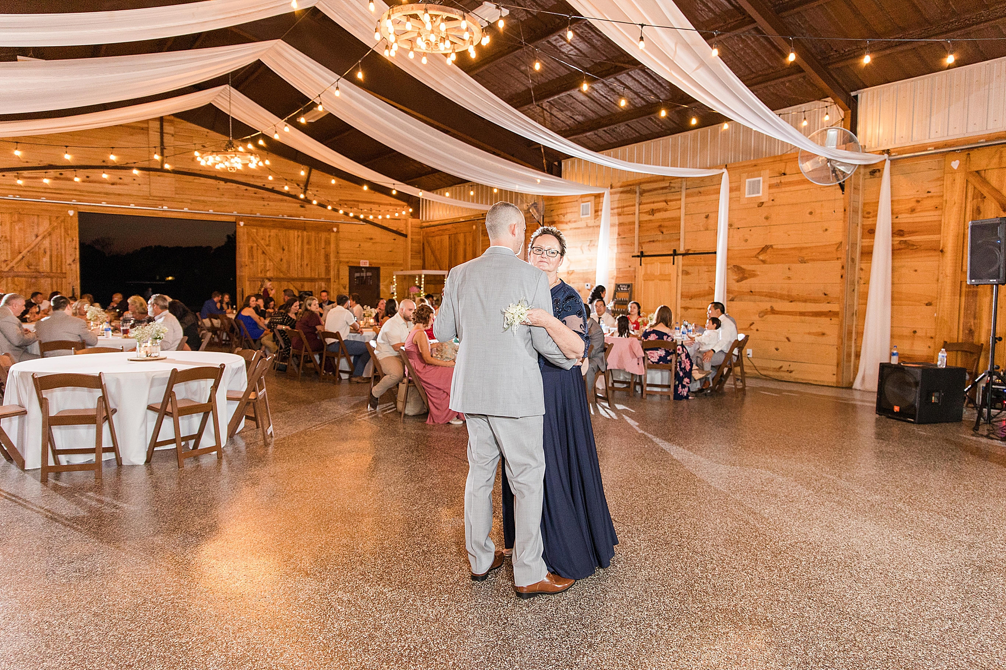 Alabama groom dances with mother during Orchard at Hayes Farm reception