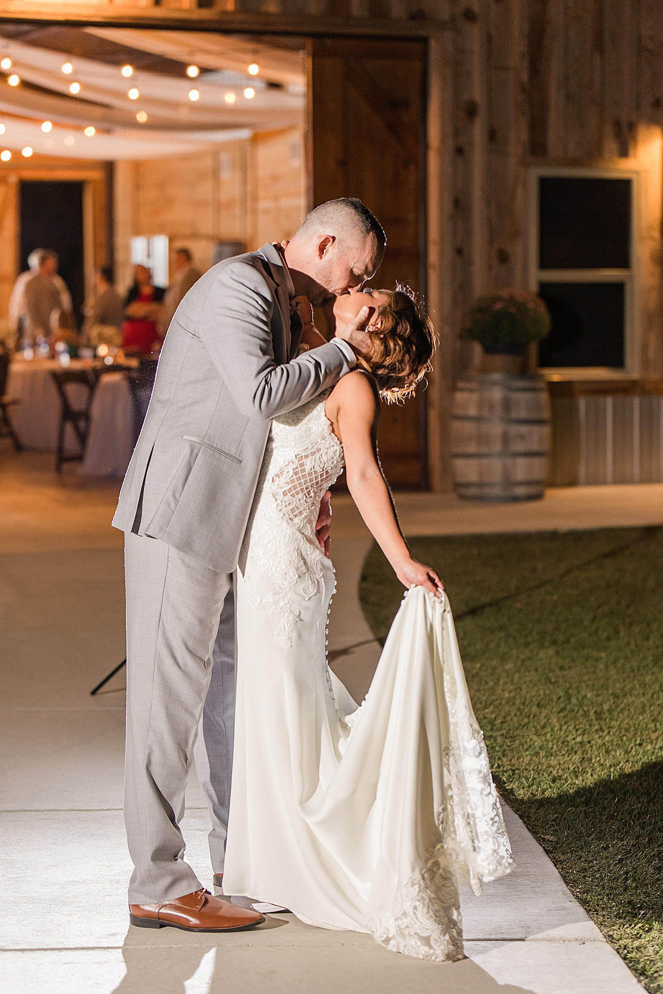 groom kisses bride outside Orchard at Hayes Farm