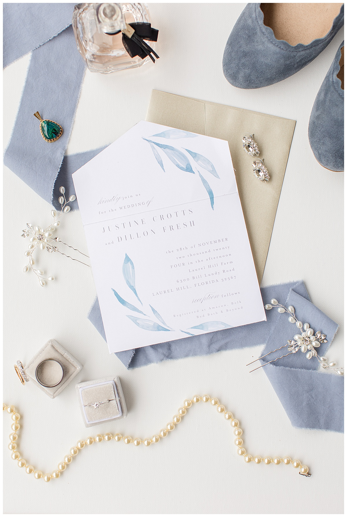 Bridal Details flat lay photo with pastel blue details for winter wedding
