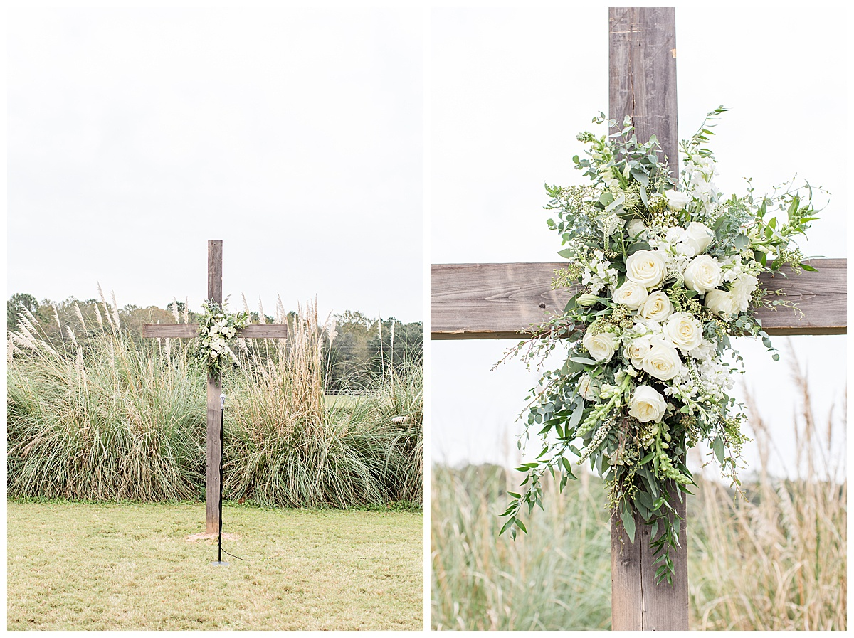 wooden cross with ivory roses for Laurel Hill Farm wedding ceremony