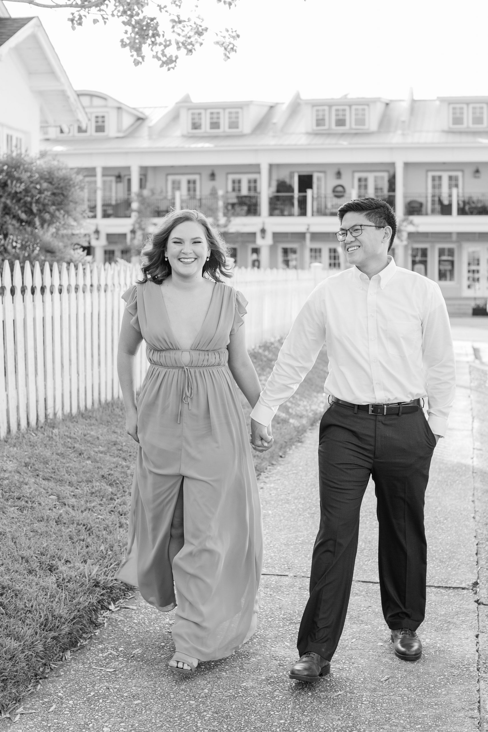 bride and groom walk through Downtown Fairhope