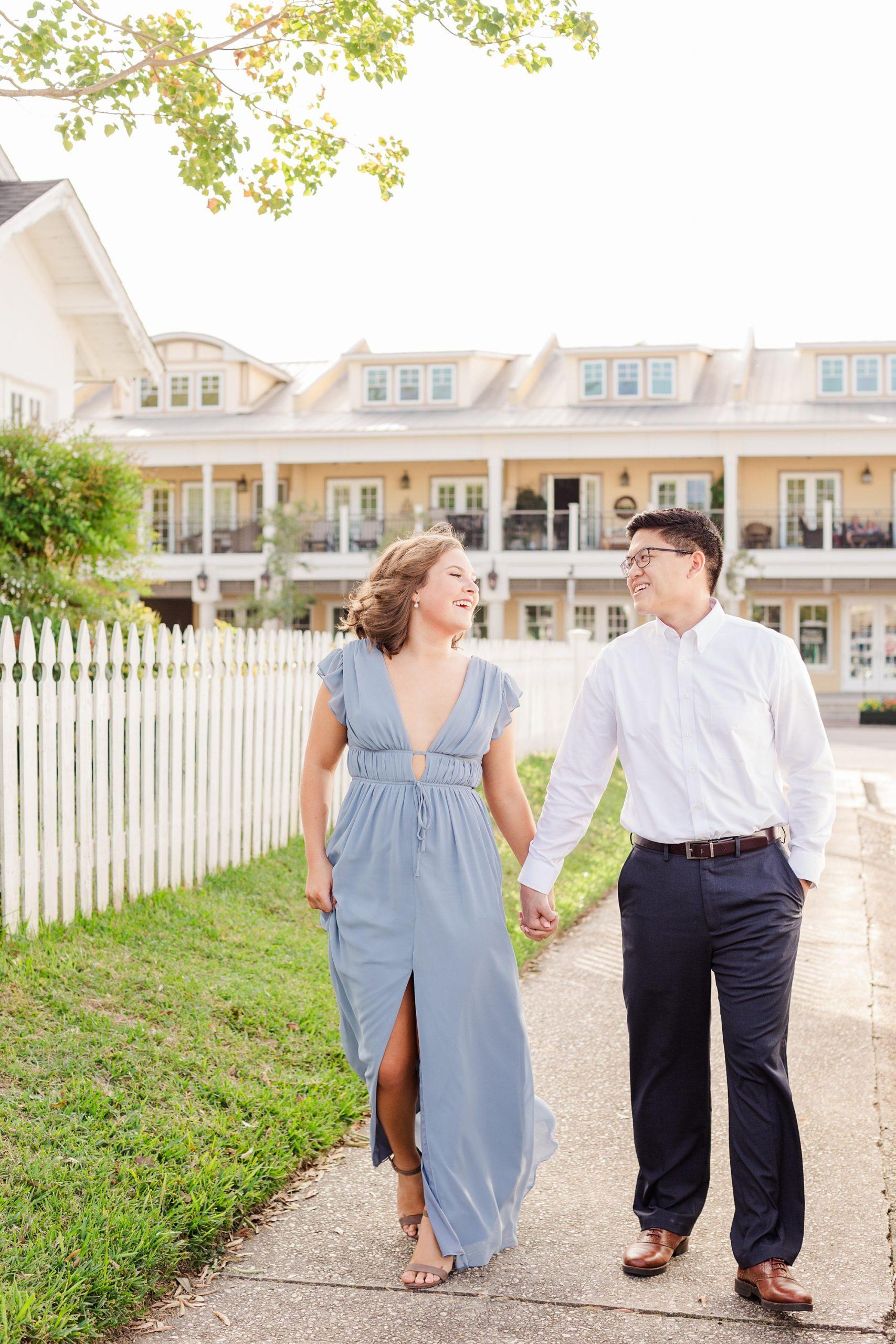 Alabama couple walks downtown during engagement photos